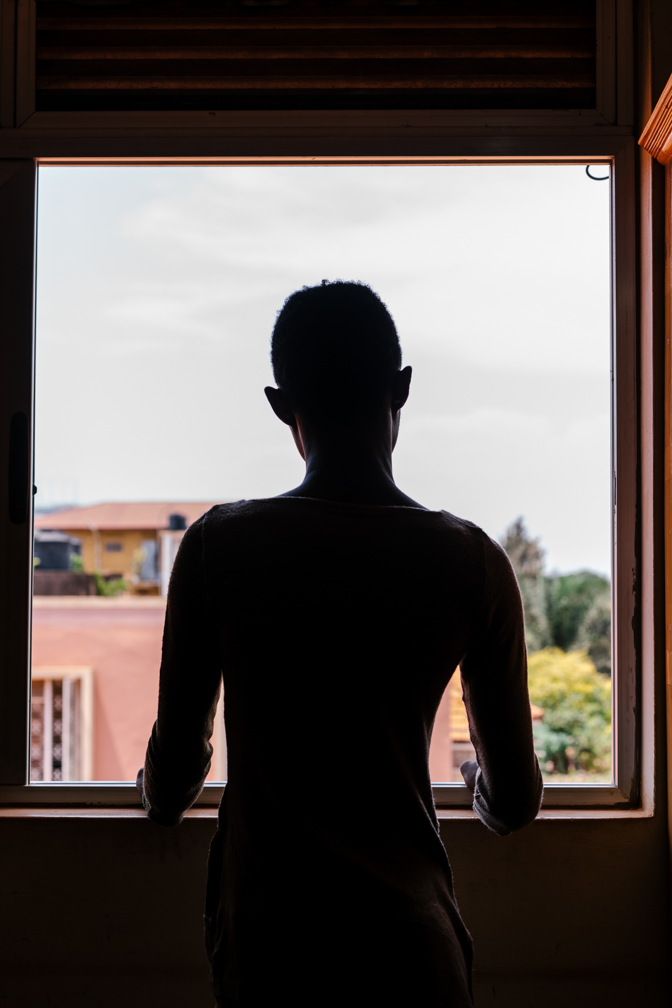 Didien, 23, a gay refugee from the Democratic Republic of the Congo, poses for a portrait in Kampala. He has had trouble starting the resettlement process because of Uganda's anti-LGBT policies and so lives in limbo.