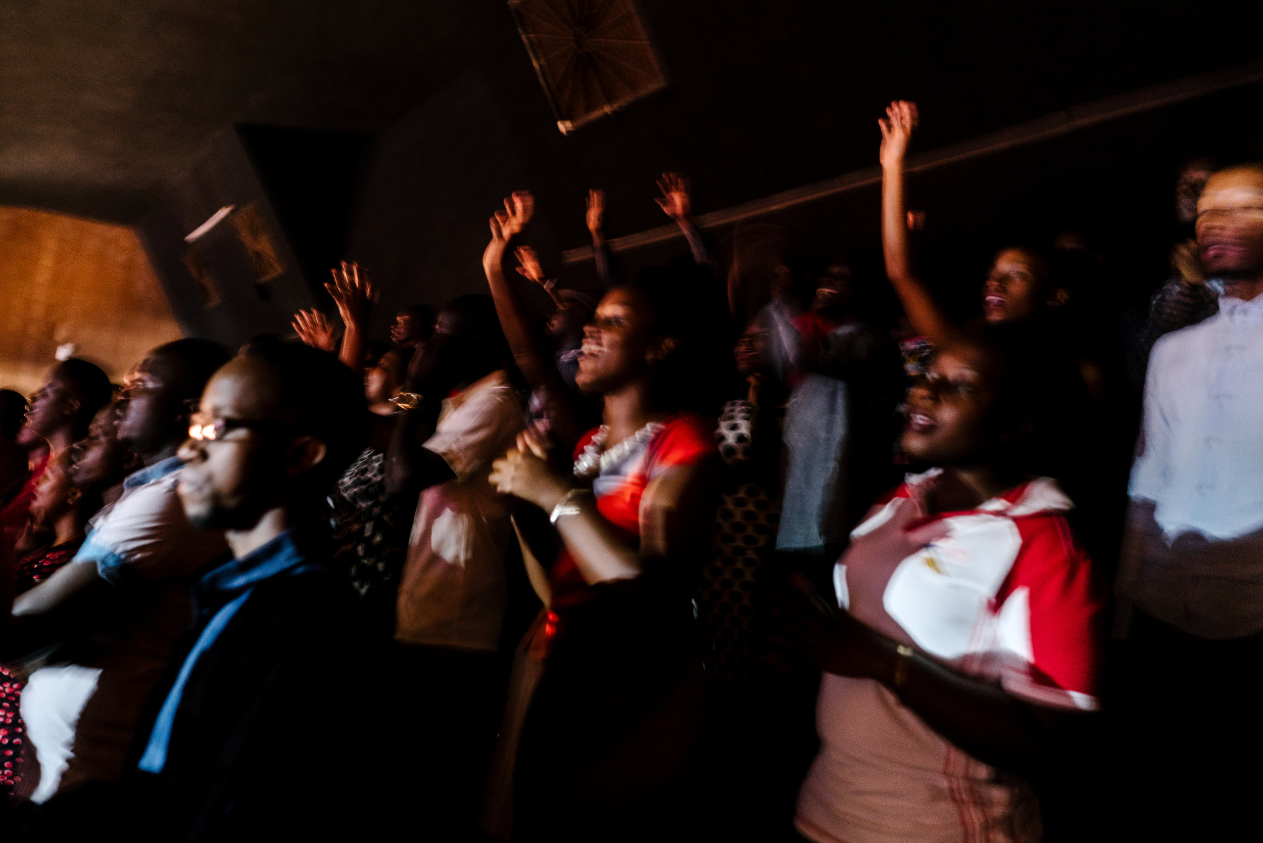 Worshippers sing at a Sunday service at Watoto church, an English speaking Pentecostal church, in downtown Kampala. Activists say Watoto, led by American pastor Gary Skinner,  has been instrumental in spreading homophobia, including through hosting American evangelical Scott Lively.