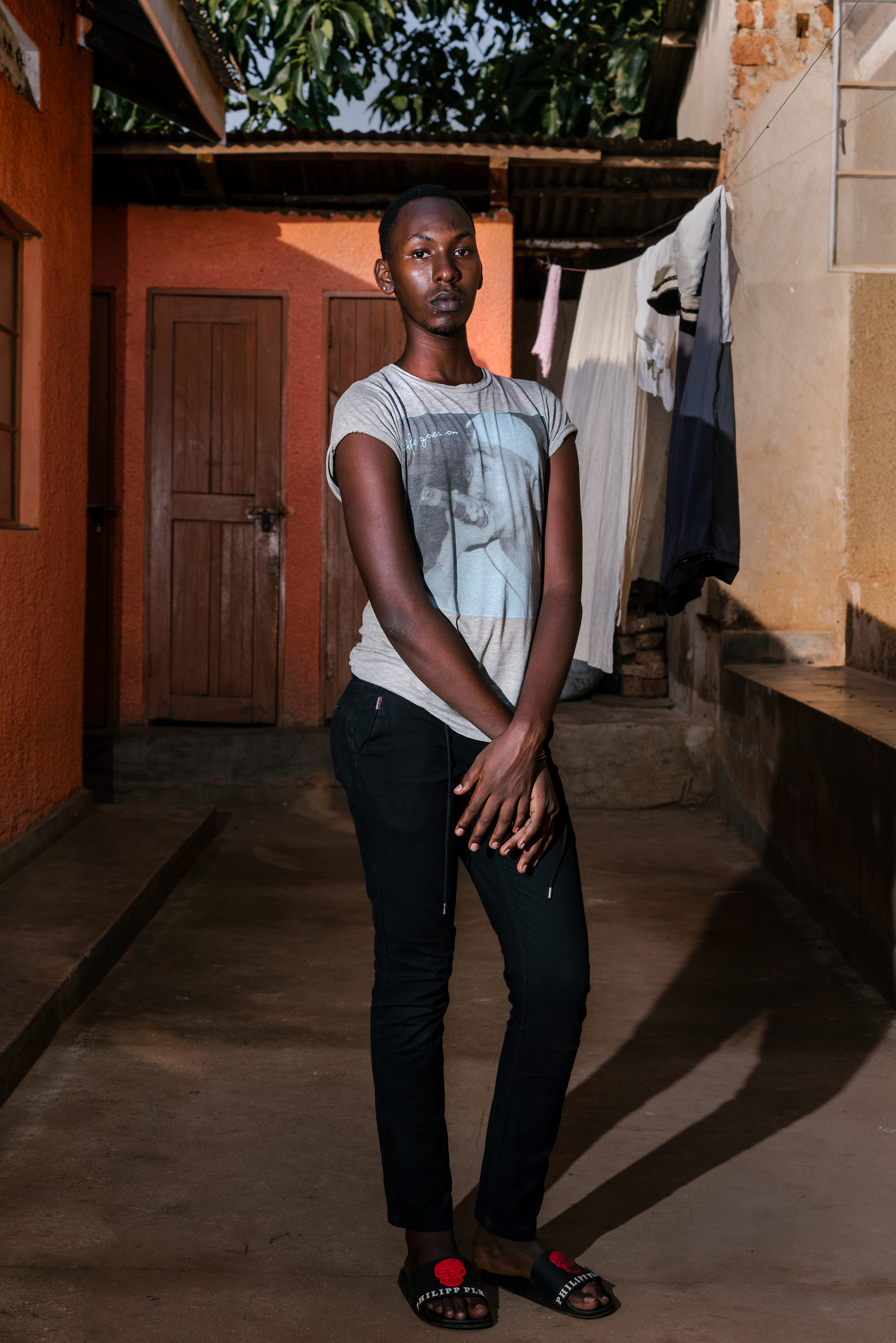 Javan poses for a portrait near her home in Kampala.