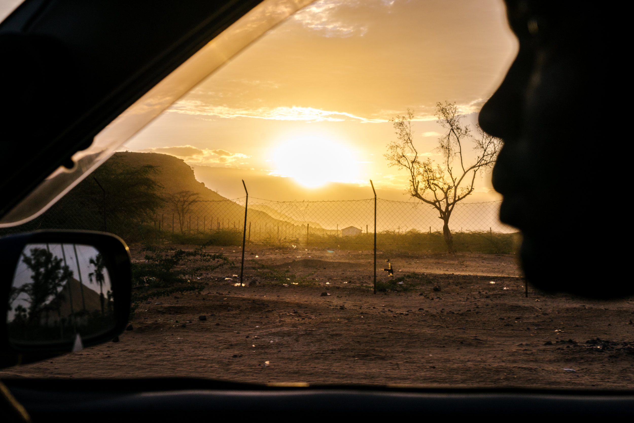 The sun sets over Lodwar, in northwestern Kenya, near where the Kakuma Refugee Camp is located. Kakuma is home to 182,000 refugees from all over the region, including many homophobic countries. Around 100 LGBTQ refugees from Uganda also call it home.