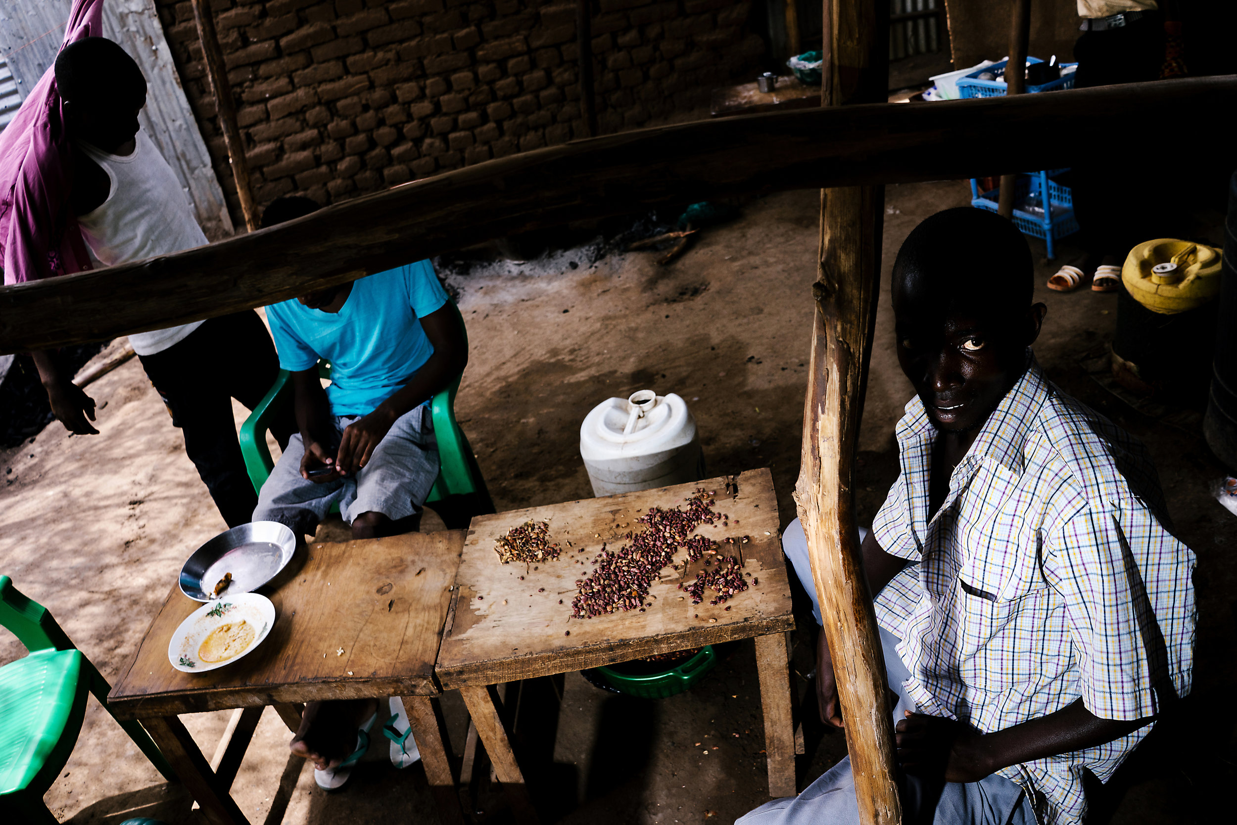 Men cook at a restaurant in Kakuma. The cafe is owned by a gay refugee from Uganda, and all of his employees are also gay Ugandans, according to him.