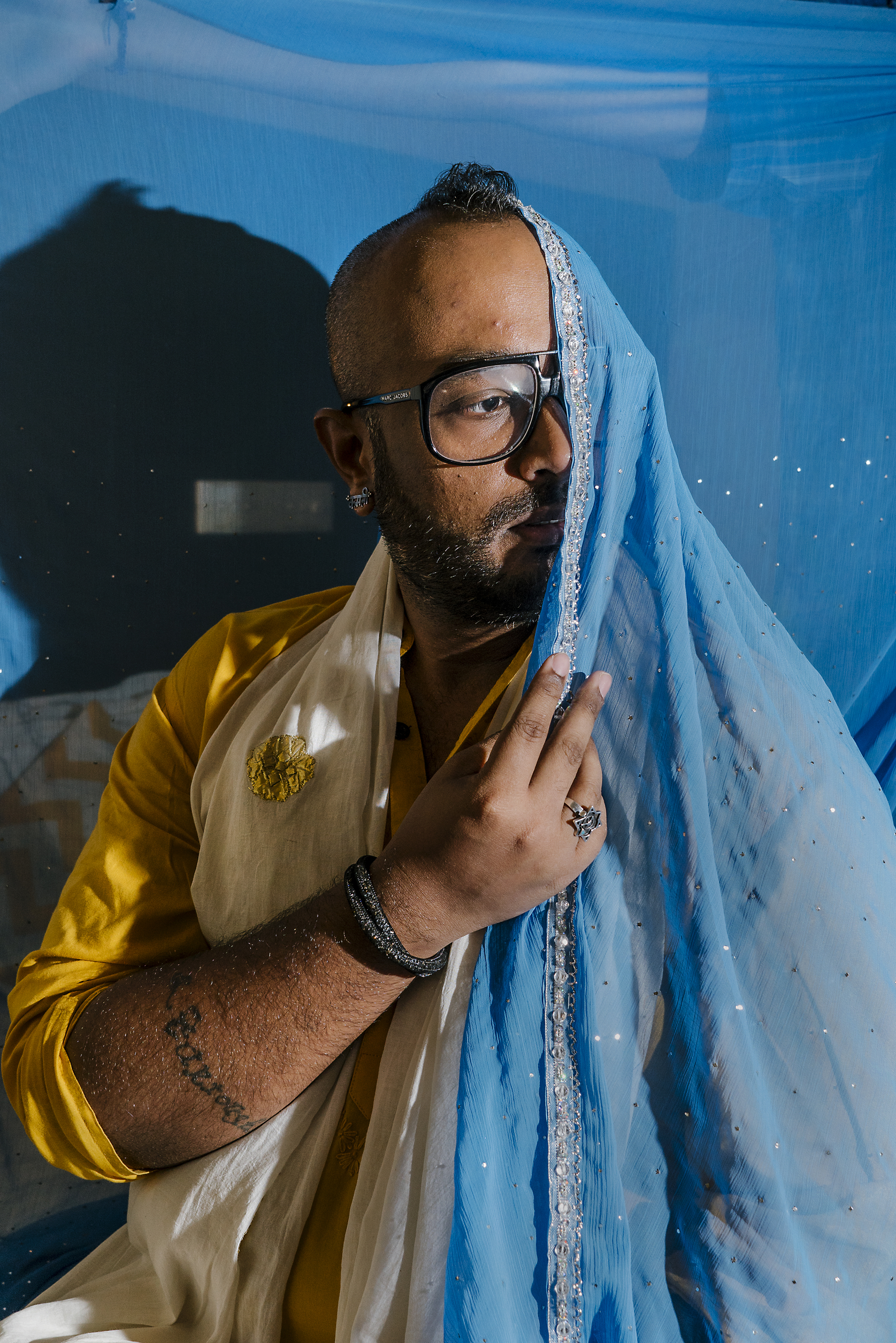 Faraz Arif Ansari, an out gay man and director of �Sisak,� an LGBTQ short film, poses for a portrait in his hotel room in New Delhi. The film tracks a brief encounter between two men who meet each other on Mumbai�s local trains.