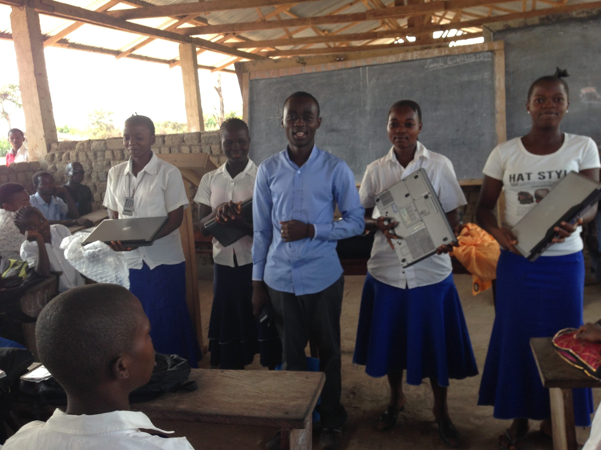 Amini and students with new computers contributed