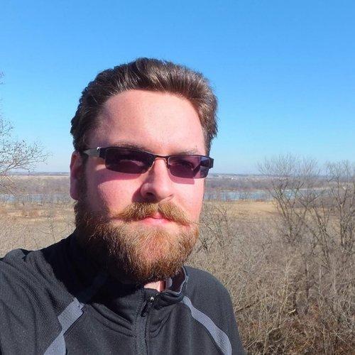 Sam Braden on a bluff near the Iowa River