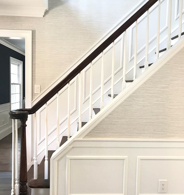 Wainscoting is always a good idea, as is vinyl 'grasscloth' wallpaper in the highest trafficked areas of the house. It was a win win for this busy one! . . . . . . . #renovation #entryfoyerdesign #staircase #wainscoting #interior #interiors #interiordecorating #interiordesign #interiordesigninspiration #longislandinteriordesign #longislandinteriordesigner #christinabyersdesign