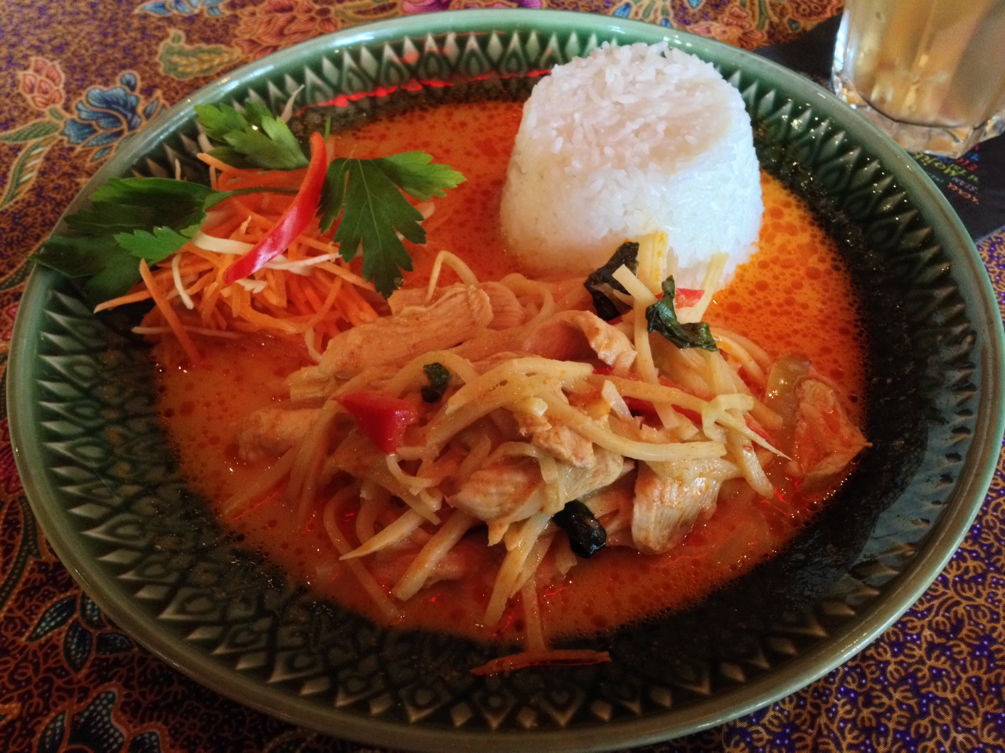 Gäng Ped Gai (chicken in red curry sauce with coconut milk, bamboo shoots, and Thai basil)
