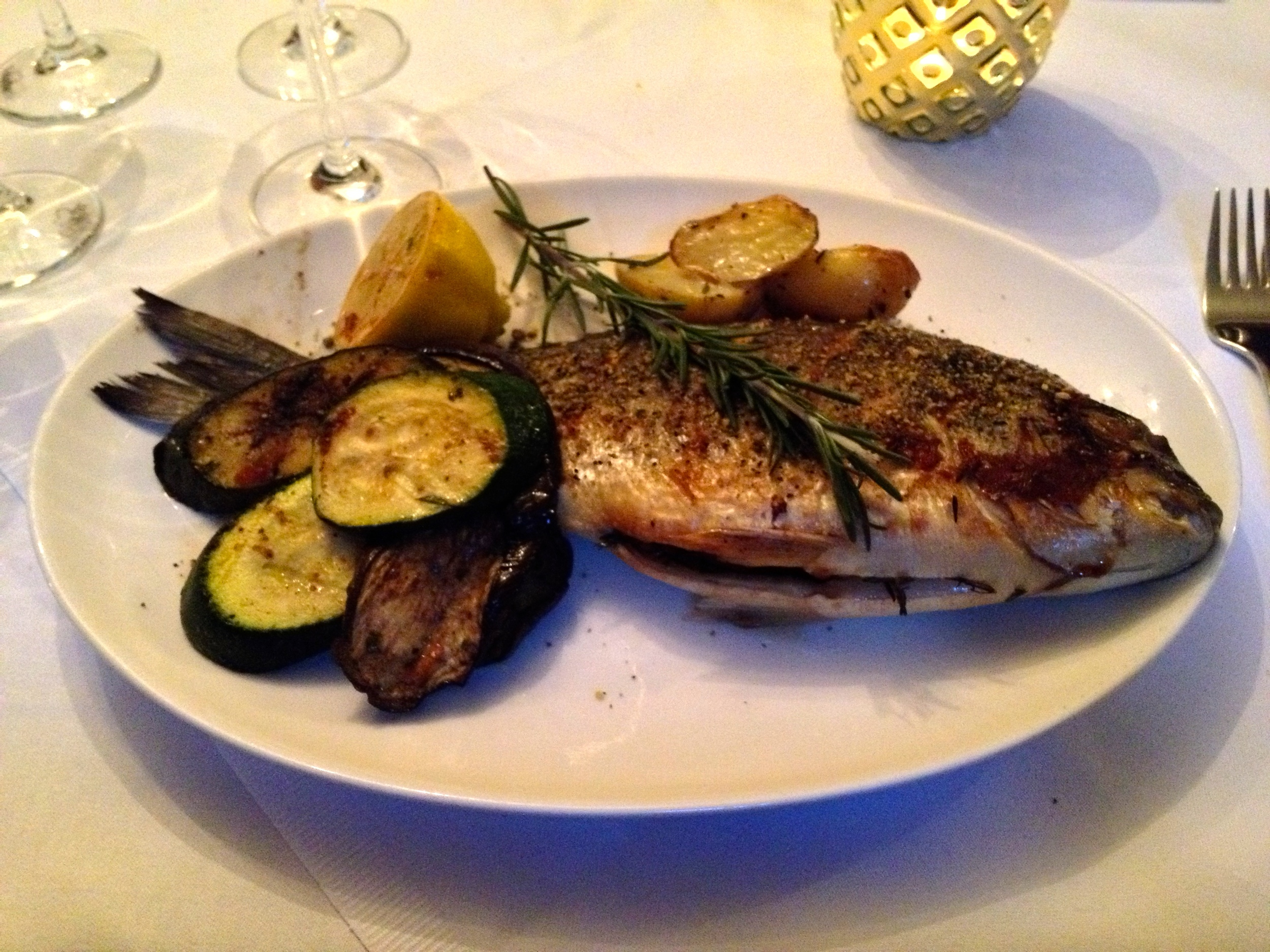 Grilled dorade with rosemary potatoes and grilled vegetables