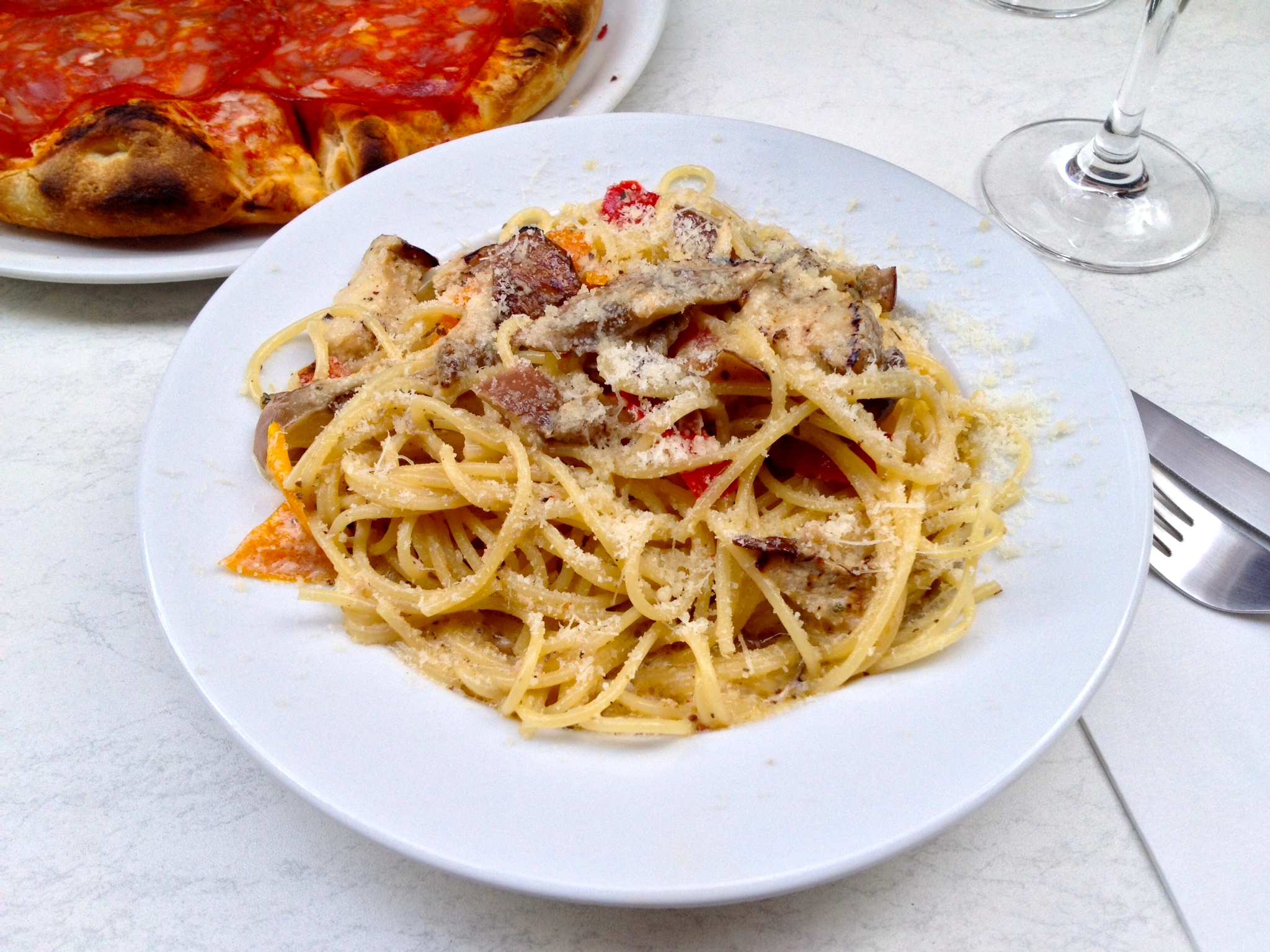 Spaghetti with eggplant, roasted peppers, capers, and parmesan