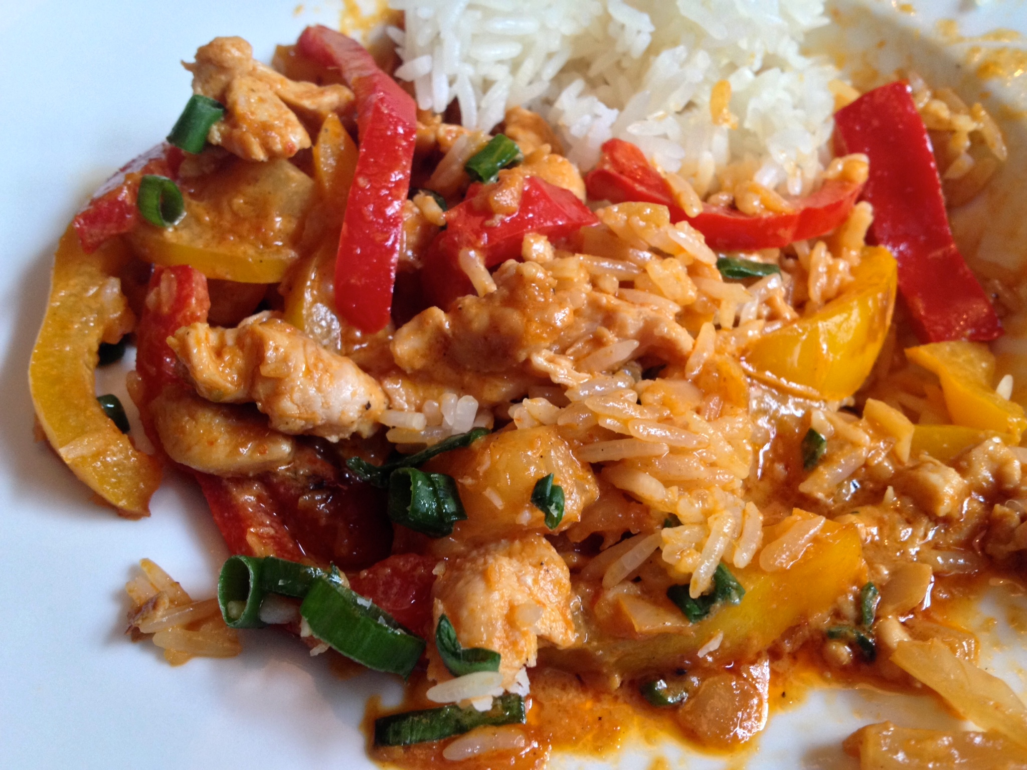 Chicken in red curry sauce with pineapple and peppers
