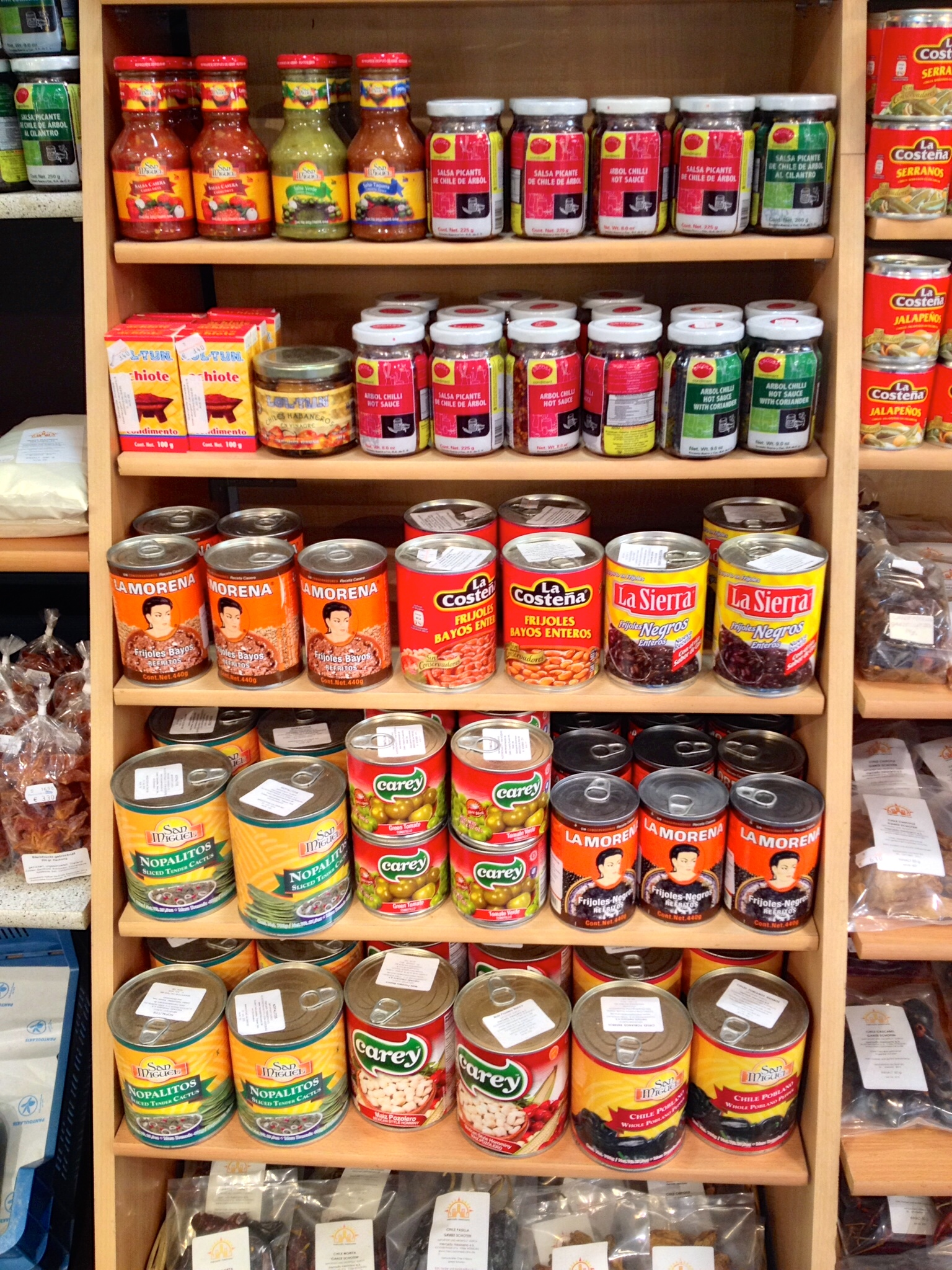 Canned peppers, beans, and sauces at El Mercado Español