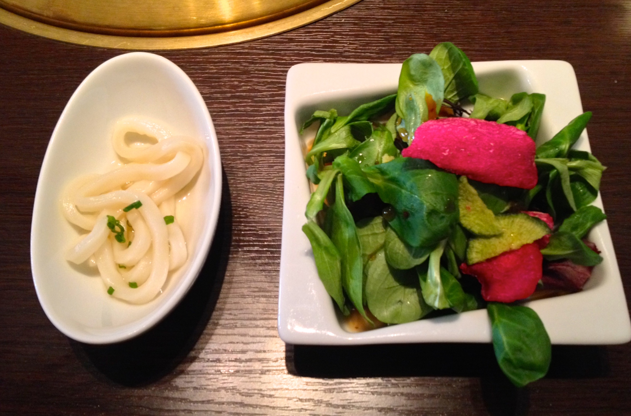 Udon noodles and a small salad with red beet chips