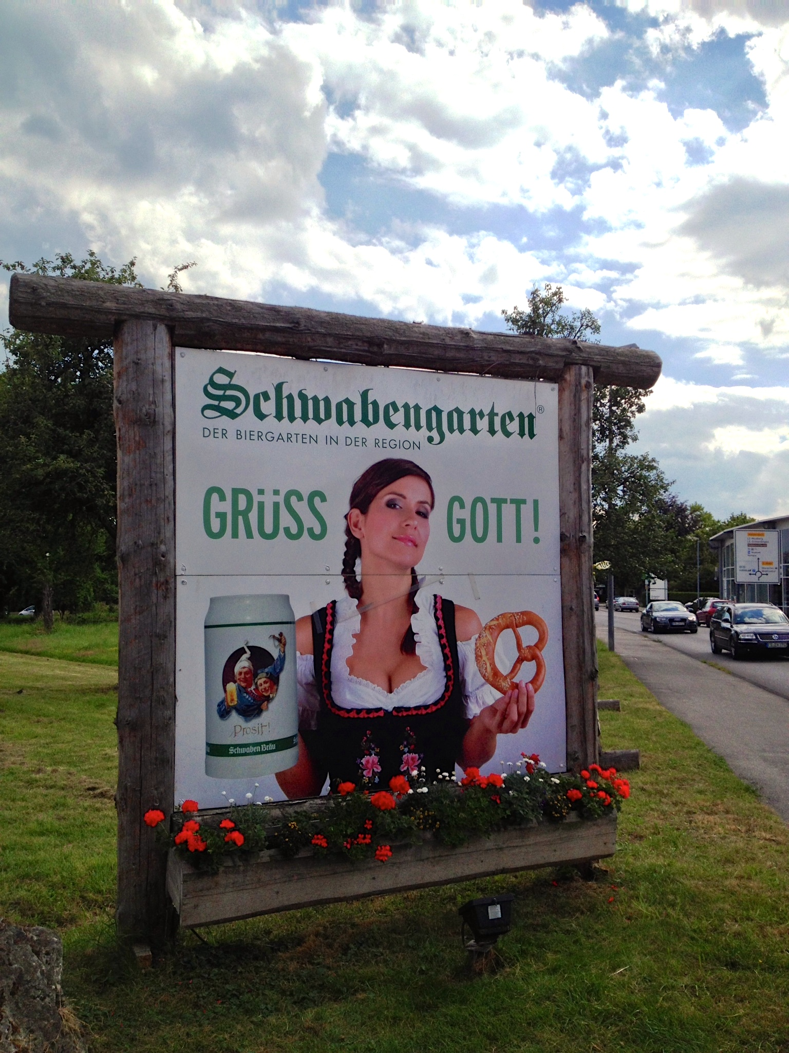 Traditionally suggestive advertisement with a woman in a  dirndl