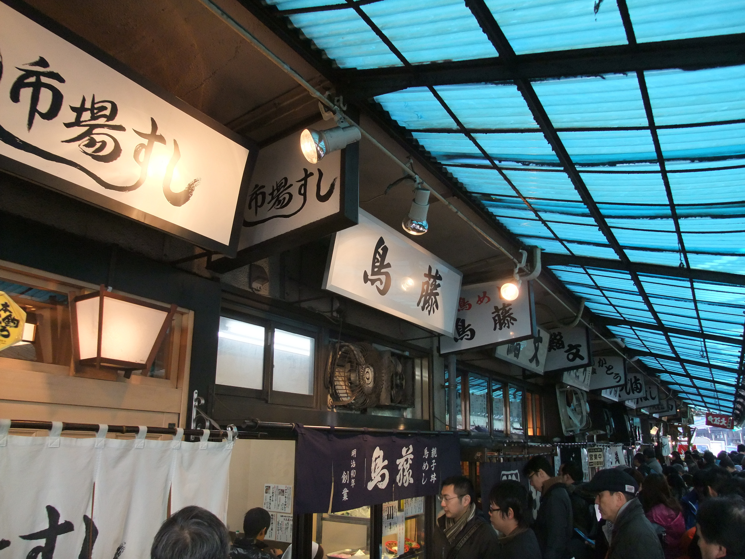 The lines to get into the sushi restaurants at the Tsukiji Fish Market.