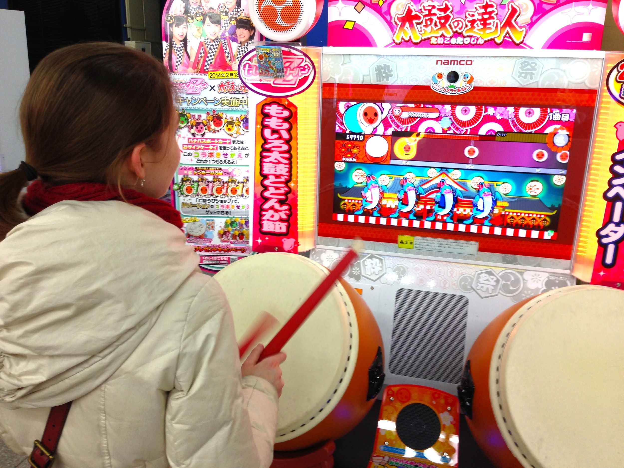 Playing taiko drum master in the arcade