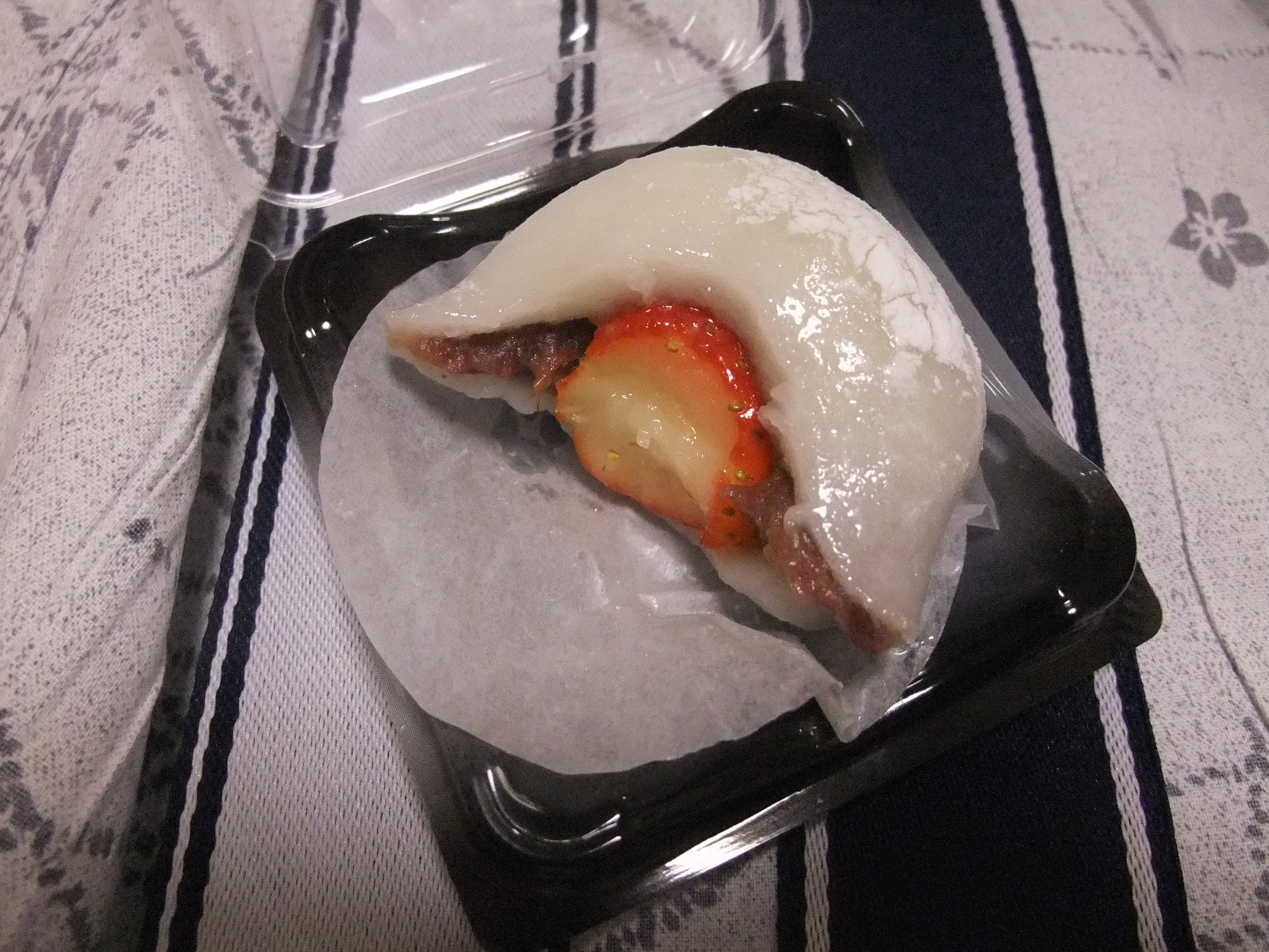 A  mochi  cake filled with a strawberry and chocolate