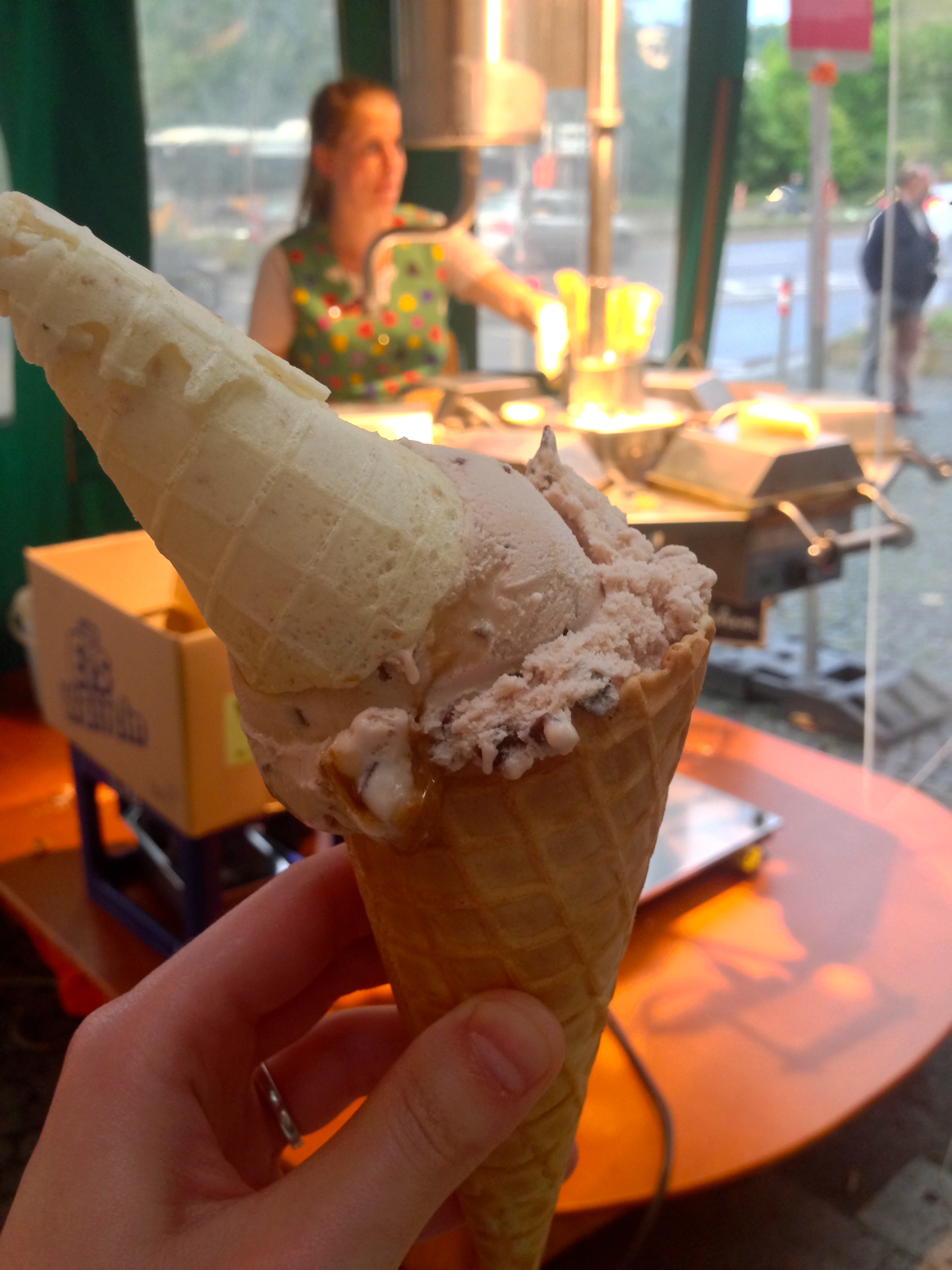 Caramel ice cream cone with the cone maker in the background