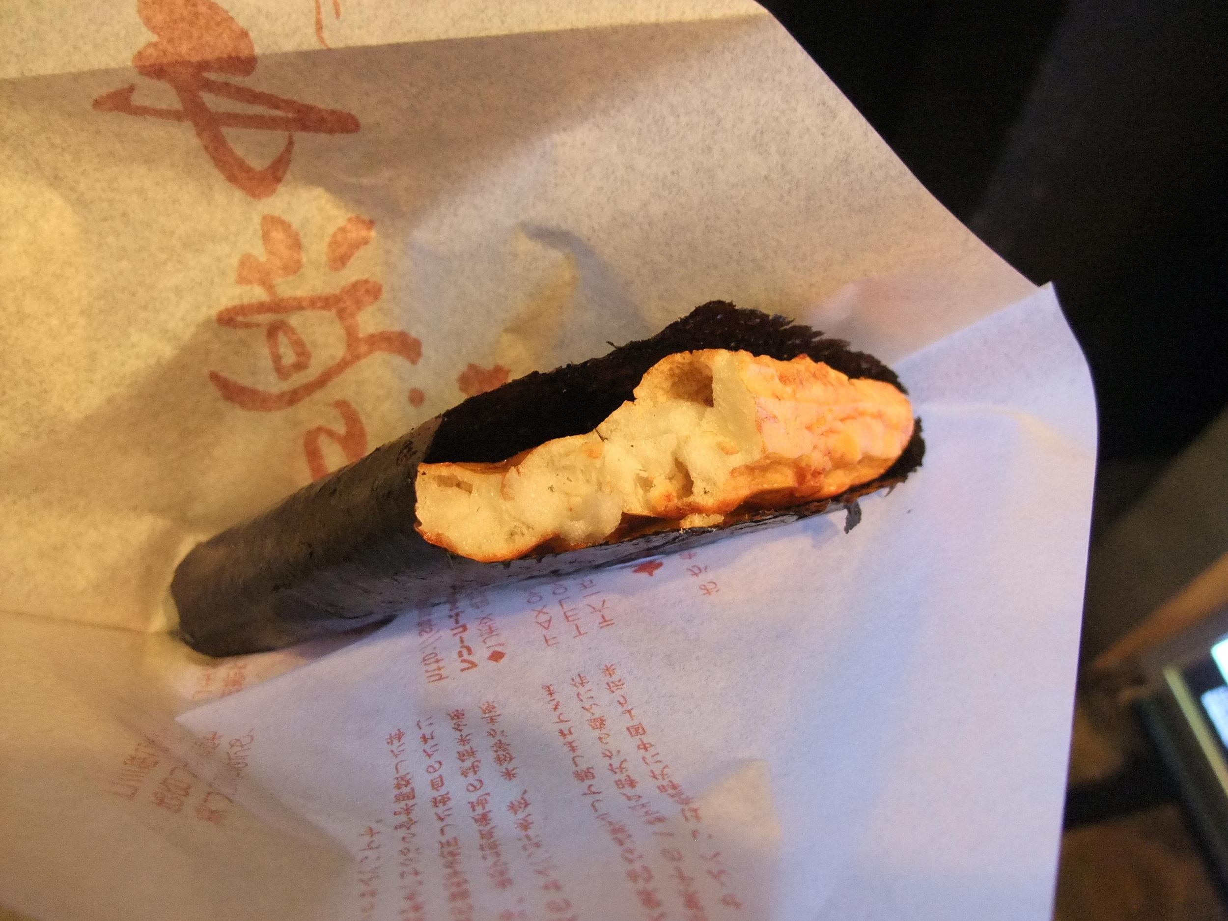 Rice cake rolled in nori (seaweed)