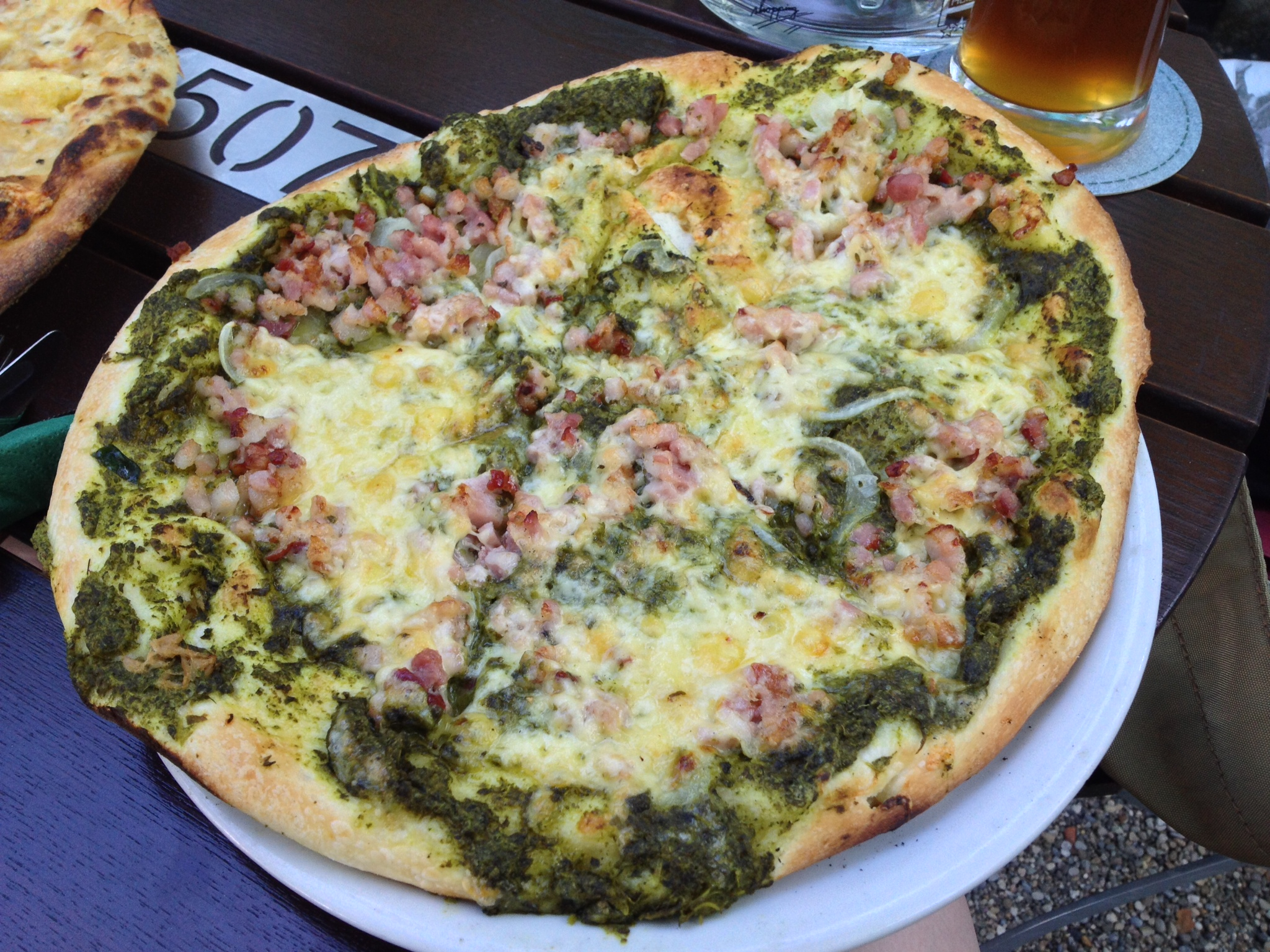 Wichtelkuchen with cream, spinach, cheese, onion, and bacon