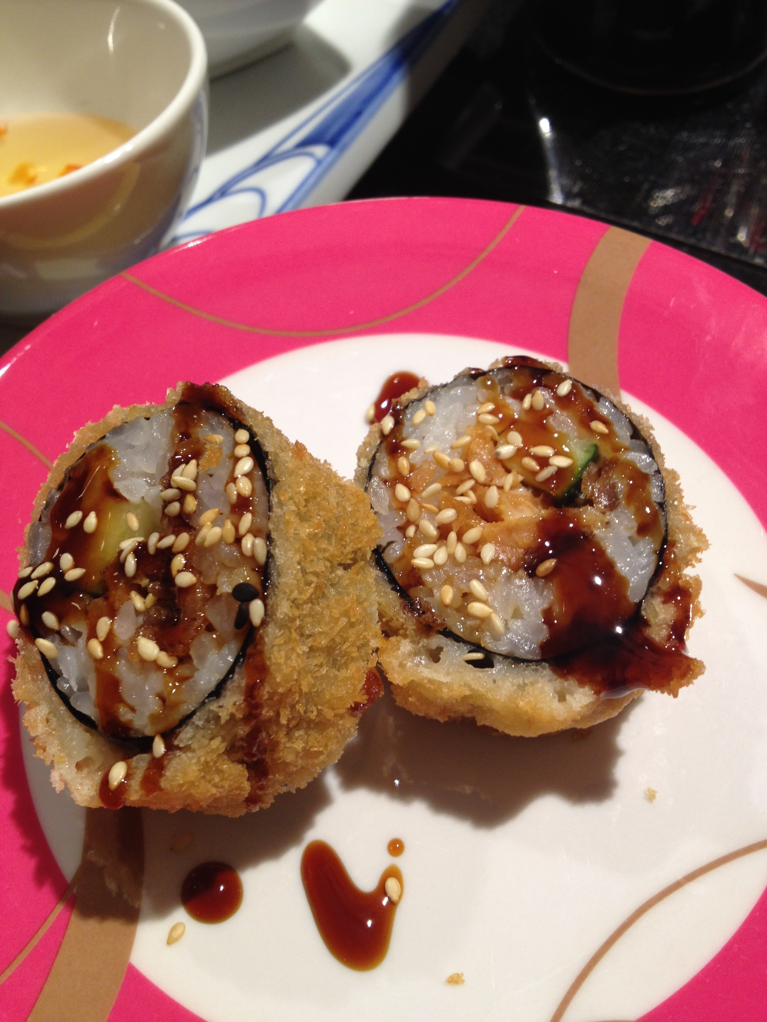 Fried salmon and cucumber roll  at Chopstix