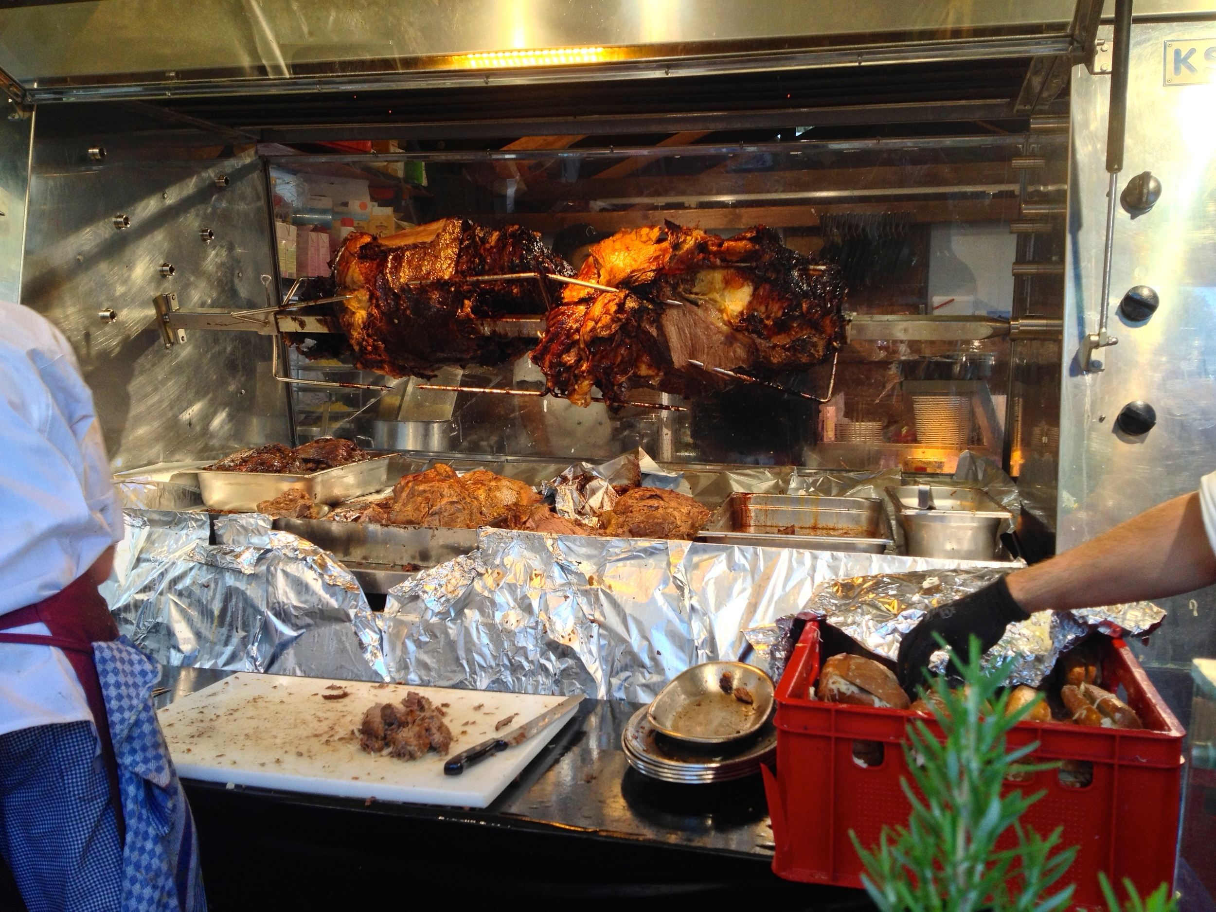 A large Ox shank roasting on a spit