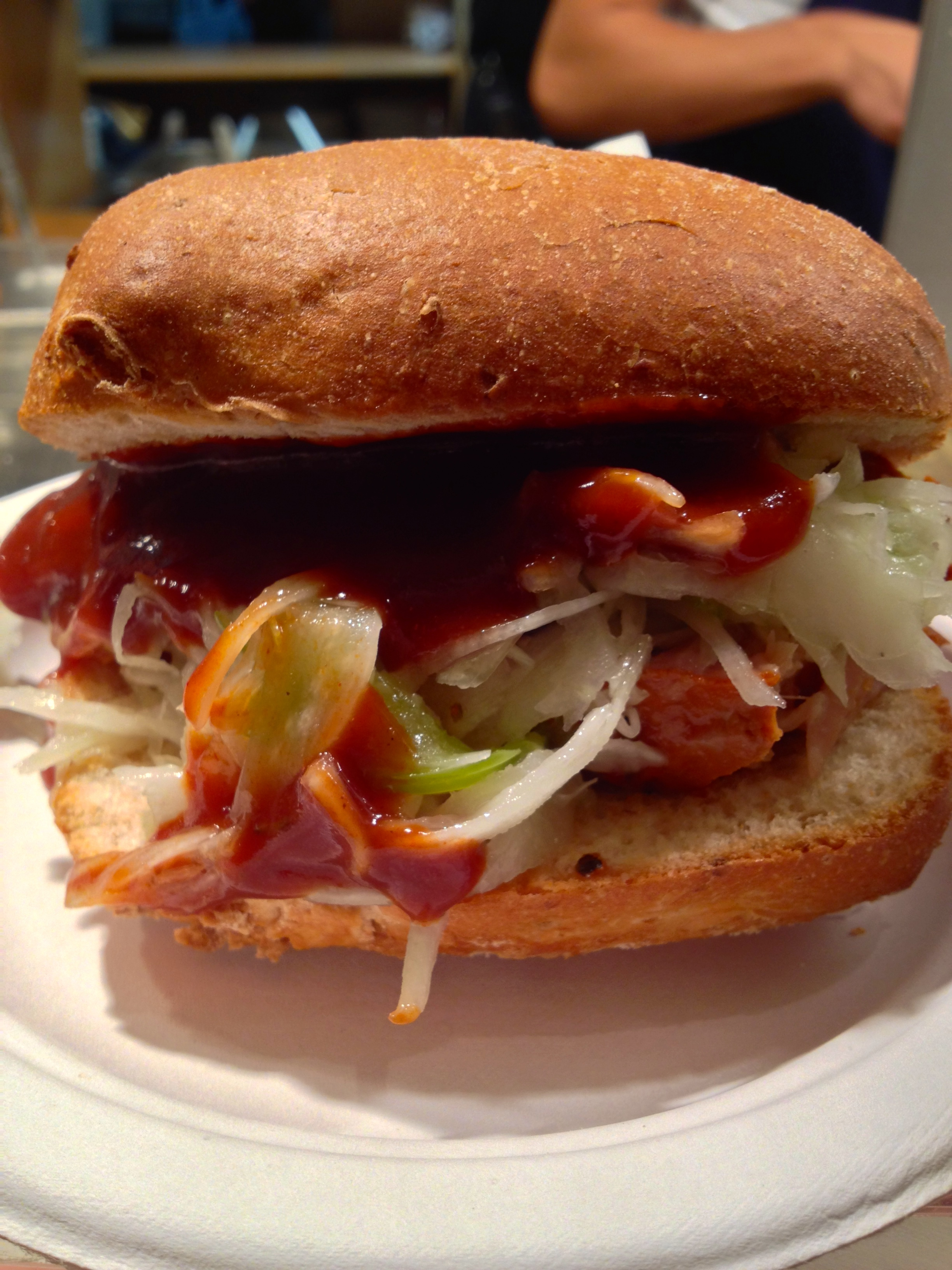 Pork sandwich with cabbage slaw and barbecue sauce