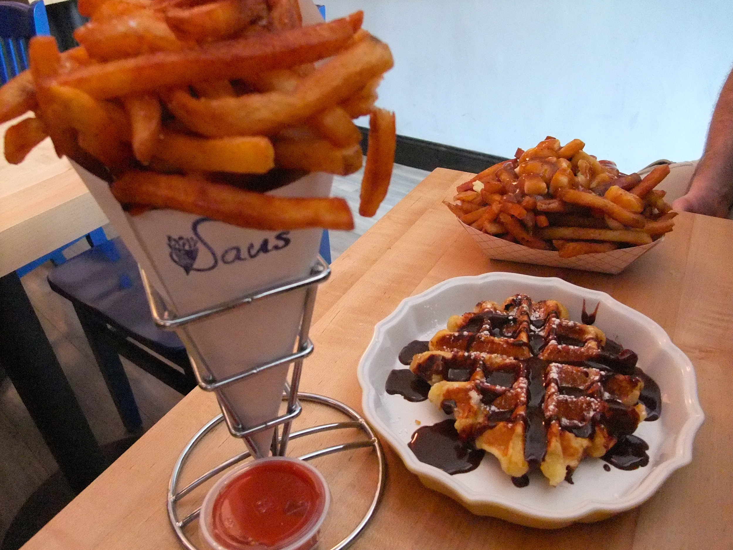 Belgian fries, a waffle, and poutine on our trip to  Saus  in Boston, Massachusetts in 2011