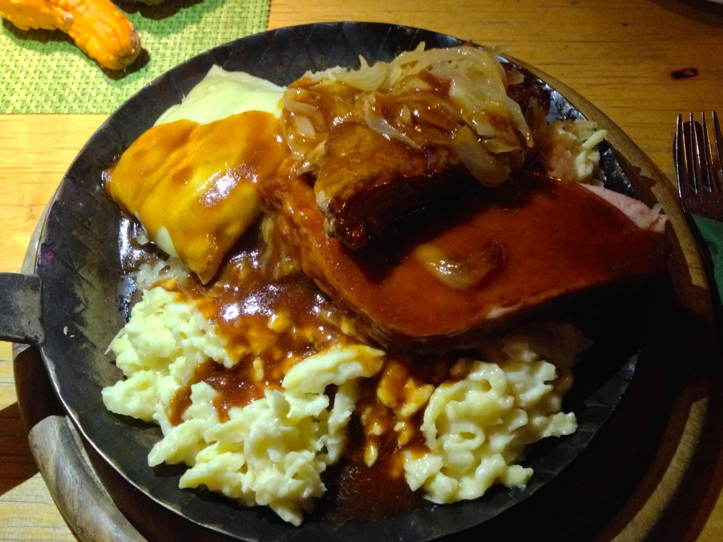 My favorite Calwer-Eck-Pfännle with sausage,  Fleischkäse, roast beef, Maultasche,  Käsespätzle , and Sauerkraut