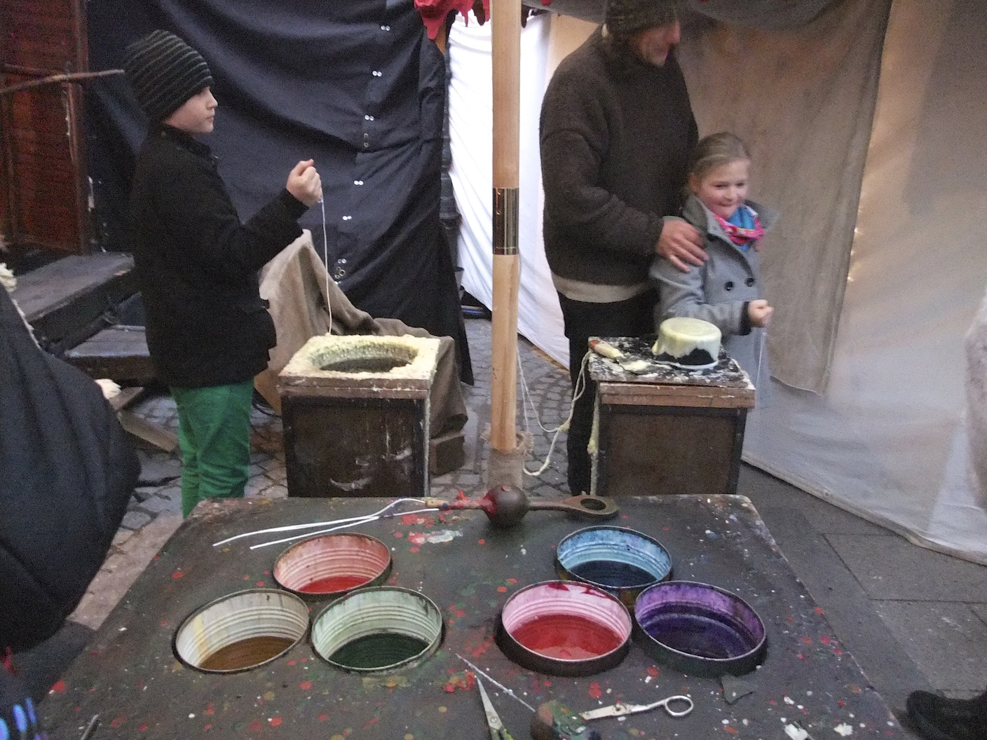 Children making candles