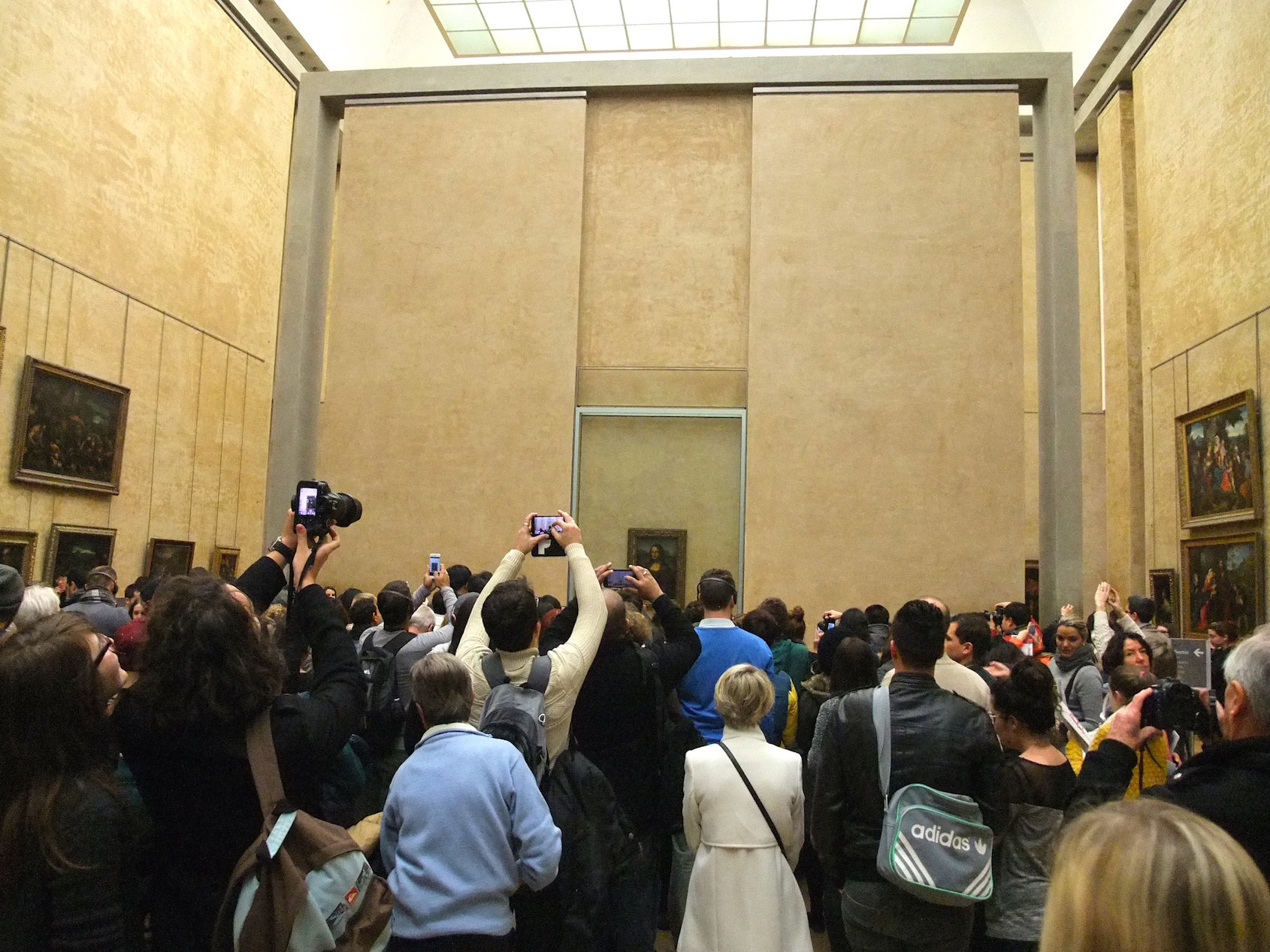 The crowd in front of the Mona Lisa at the  Louvre
