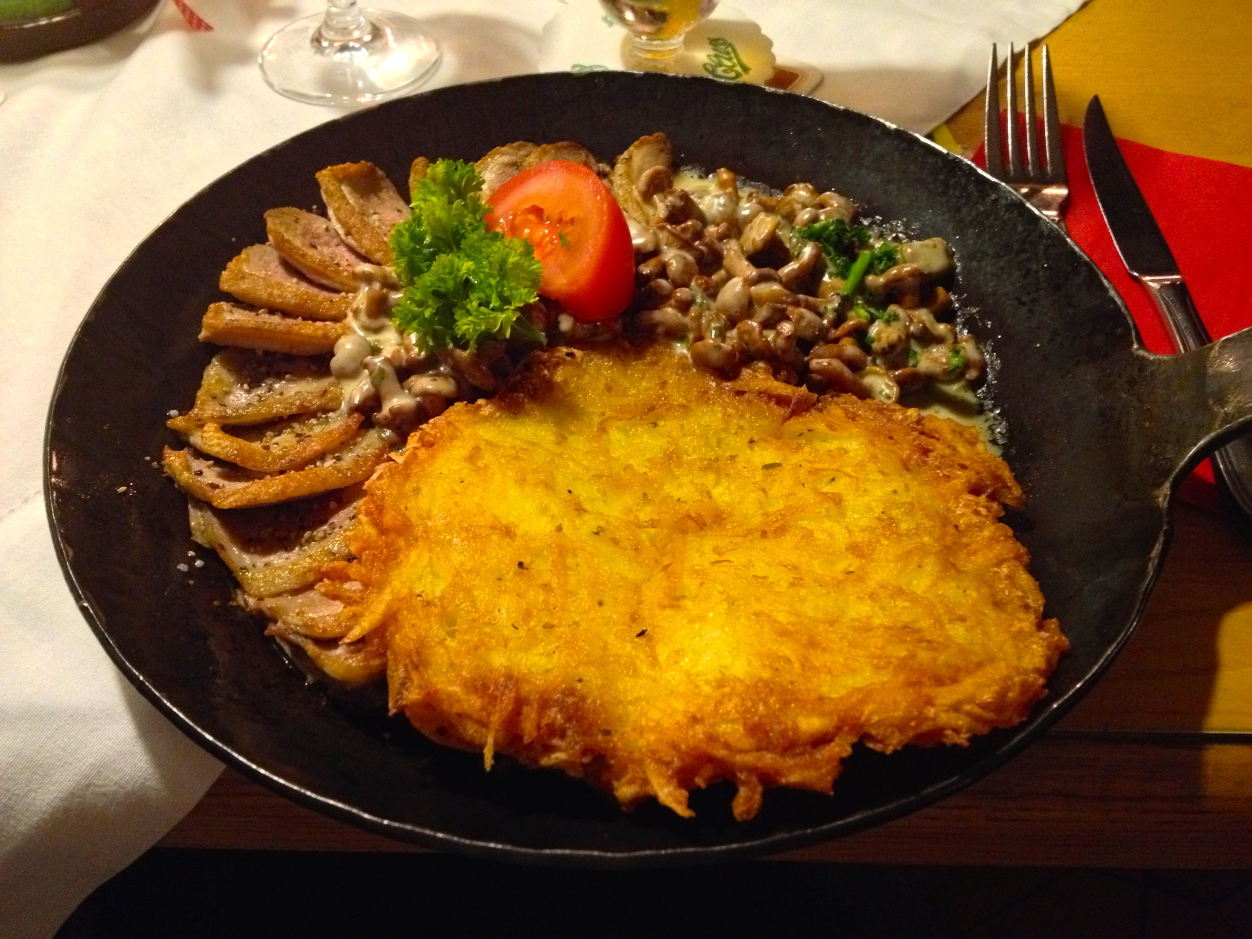 The duck pan with crispy duck, creamy mushrooms, and a potato pancake