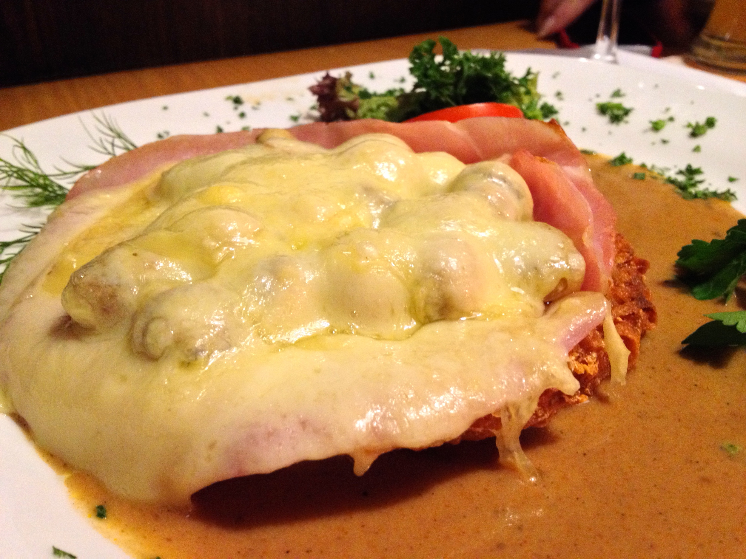 Matt's potato pancake or  Rösti topped with hame, mushrooms, and cheese and smothered in sauce