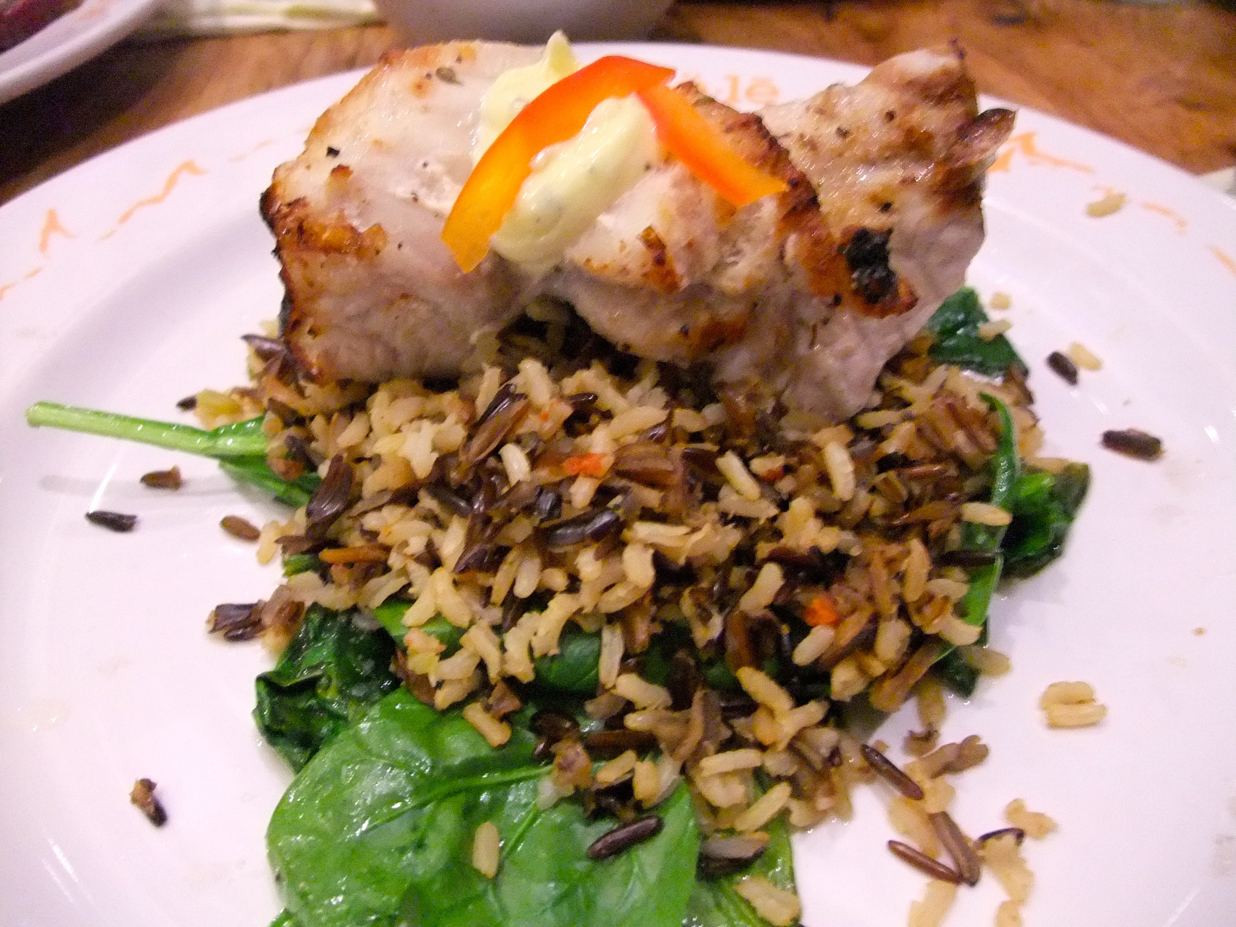 Snapper with wild rice and truffled spinach at Ulele