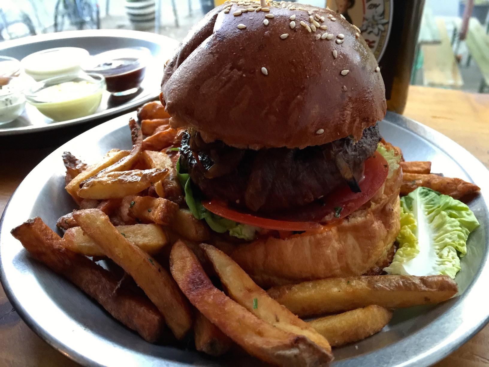 "Matt's ""Juicy Lucy"" burger and regular fries"