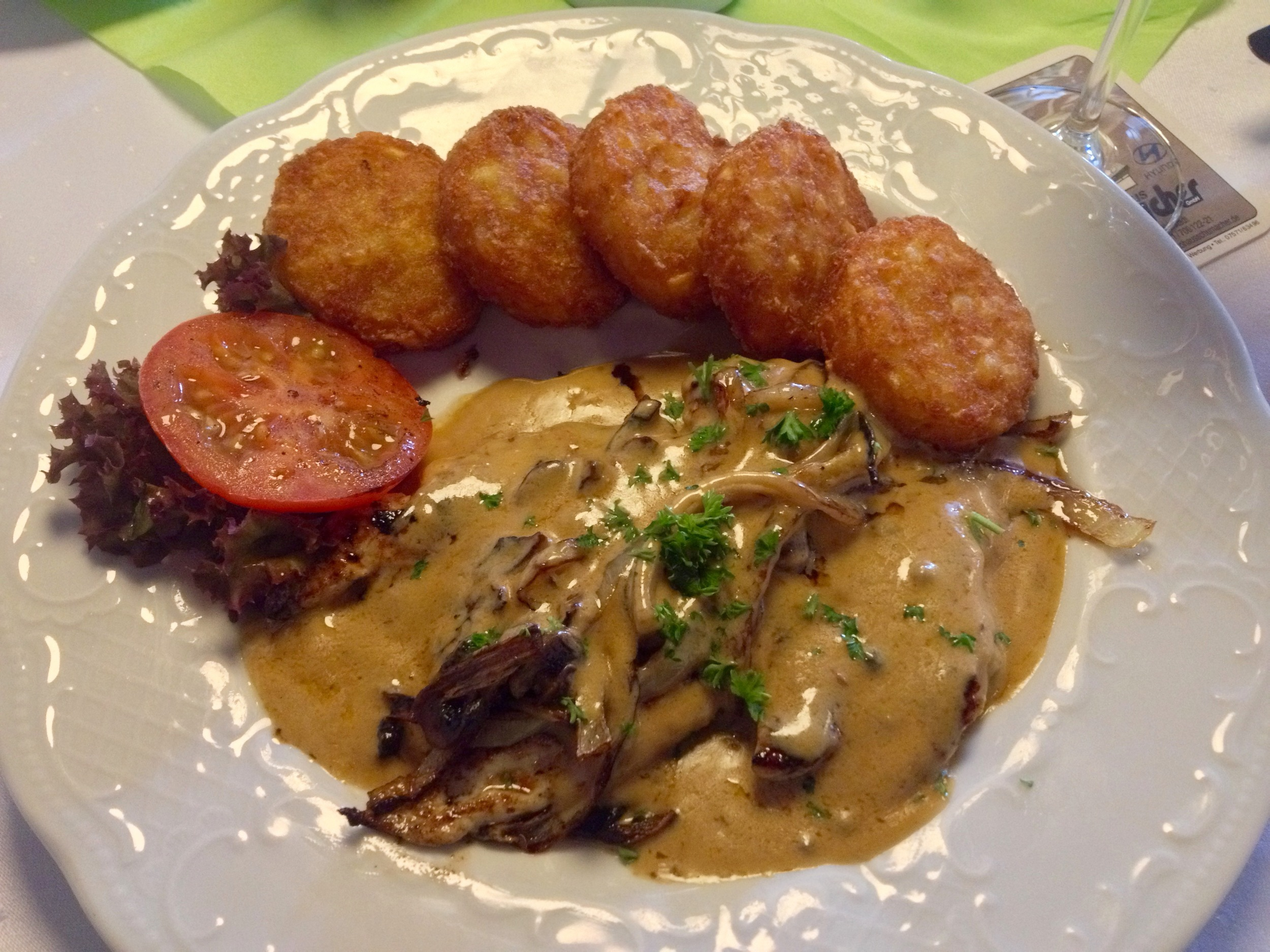 Chicken breast smothered in mushrooms, onions, and a pepper sauce served with potato  röstis