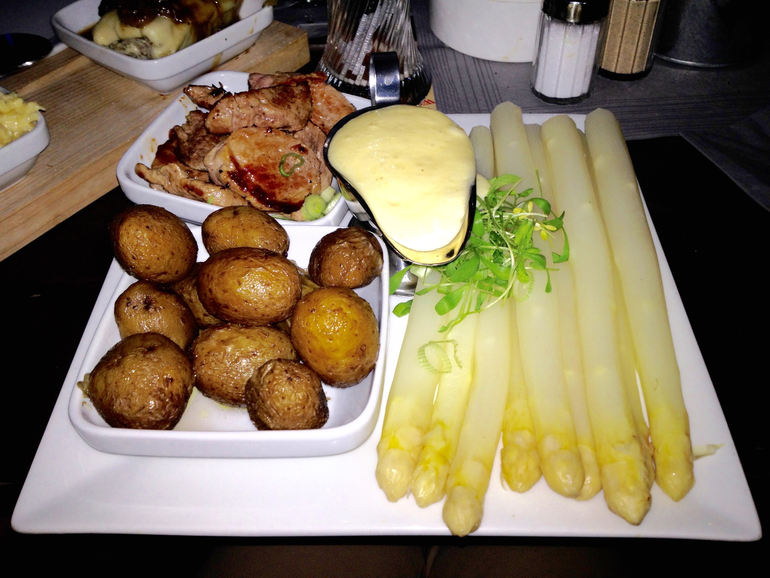 My special from the  Spargel  menu: white asparagus with pan-fried pork medallions, new potatoes, and hollandaise sauce