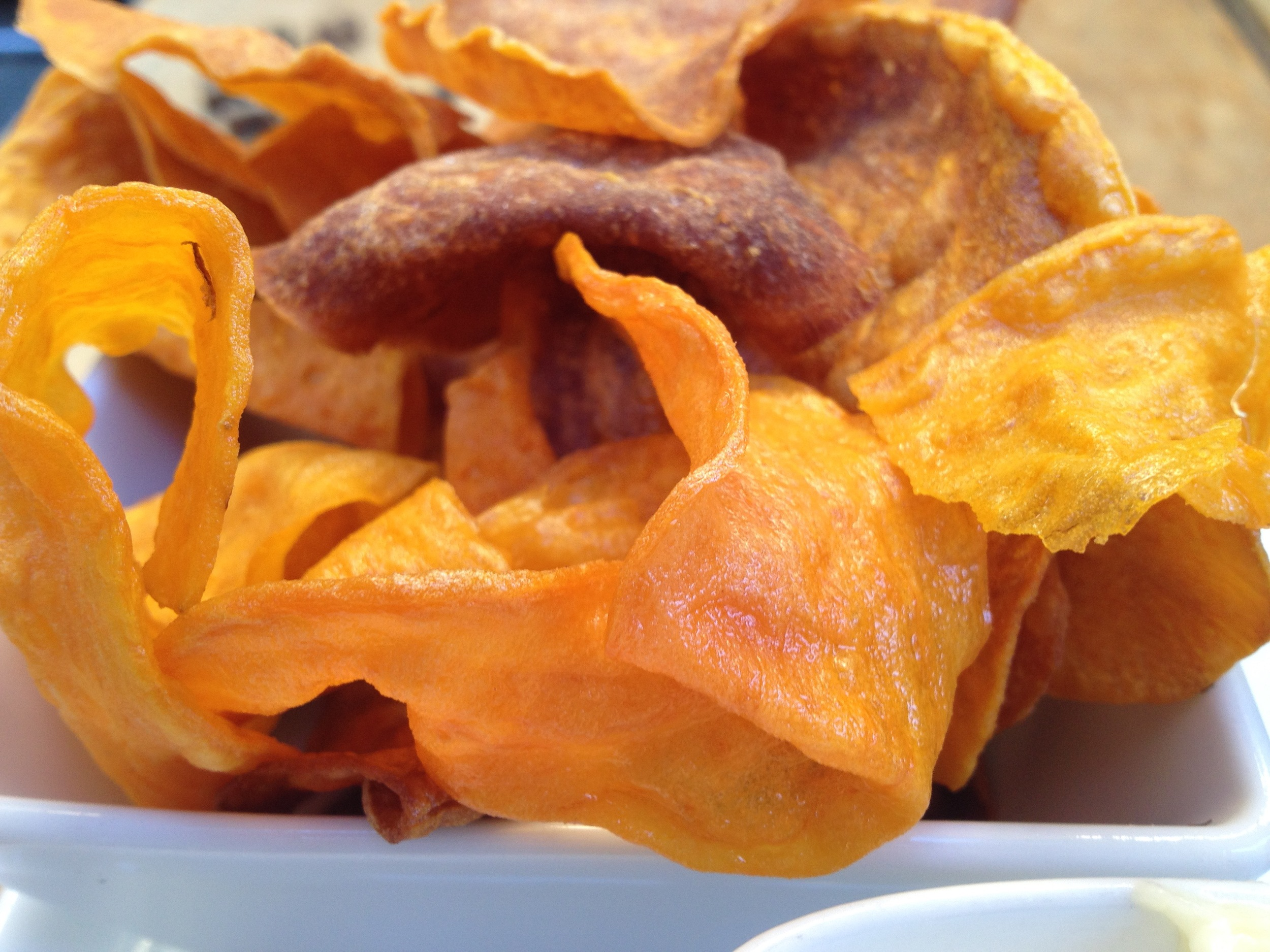 A close-up of the fresh-fried sweet potato chips