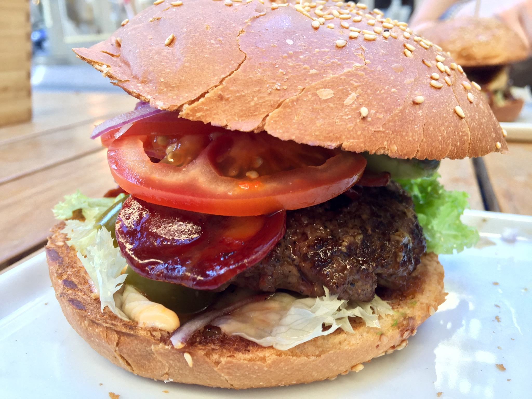 A side view of the Los Cojones Mexicanos burger