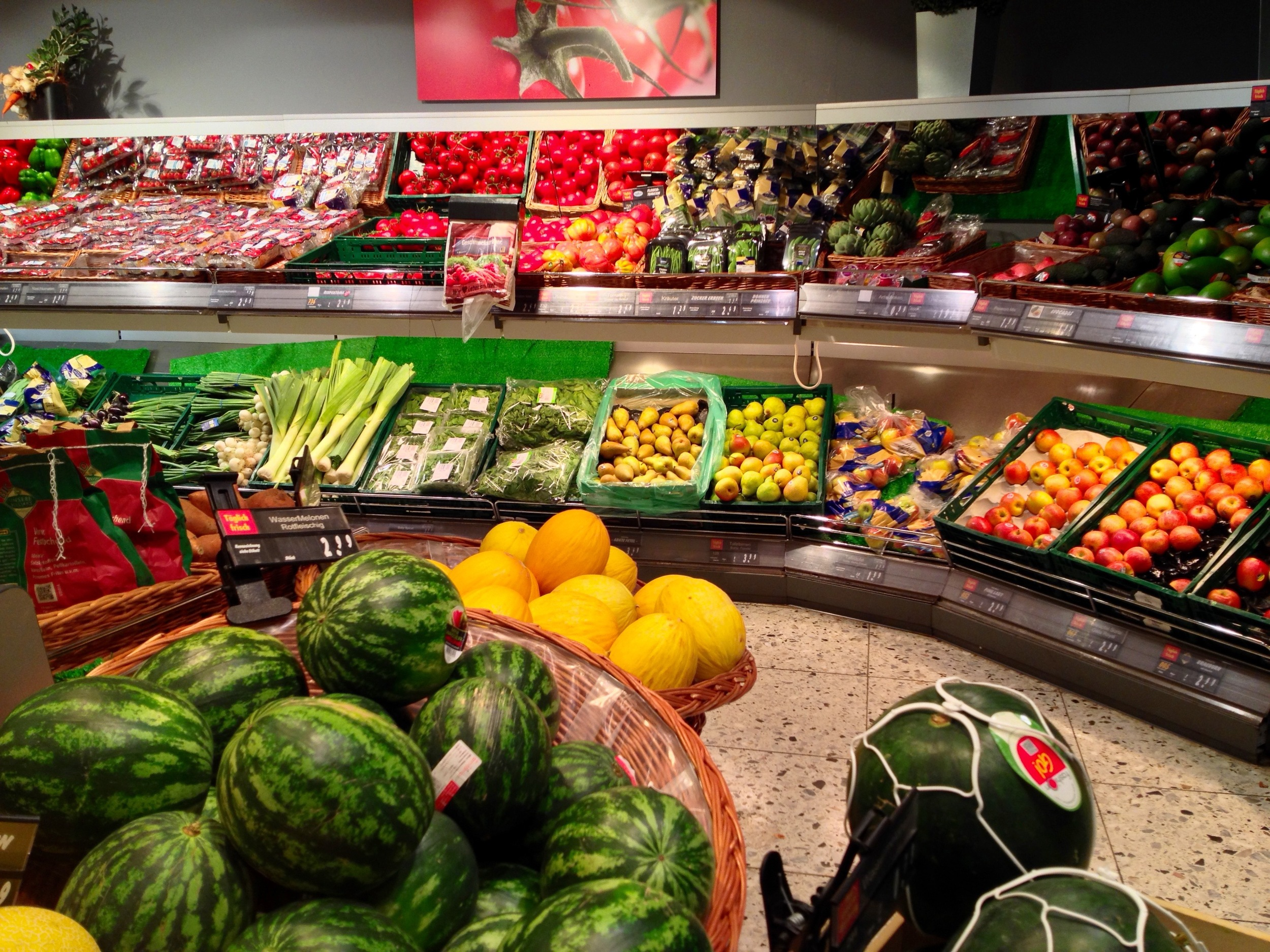 Part of the produce aisle with summer fruits in season