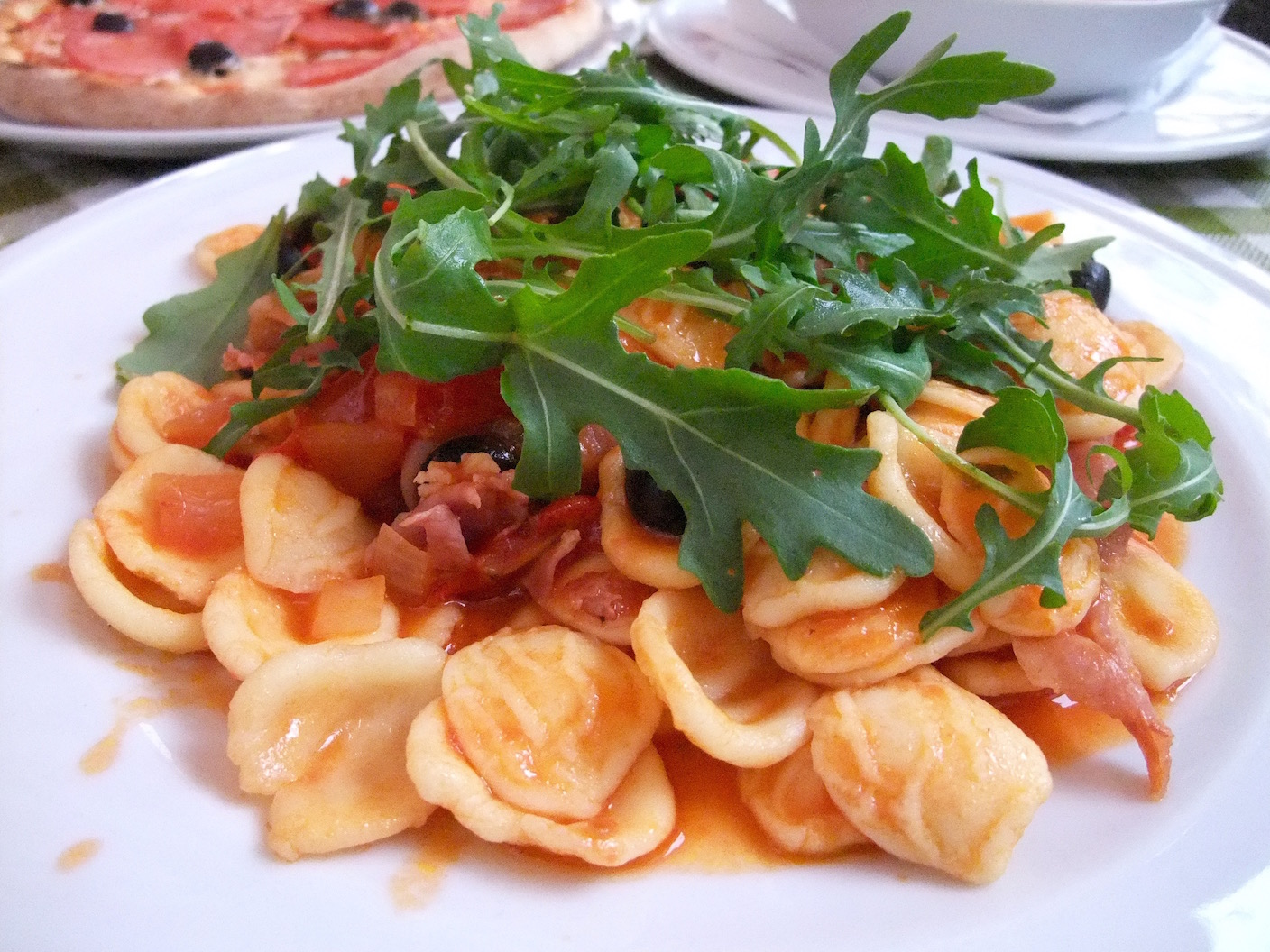 My  Orecchiette  with ham, garlic, onions, olives, tomatoes, parmesan, and arugula