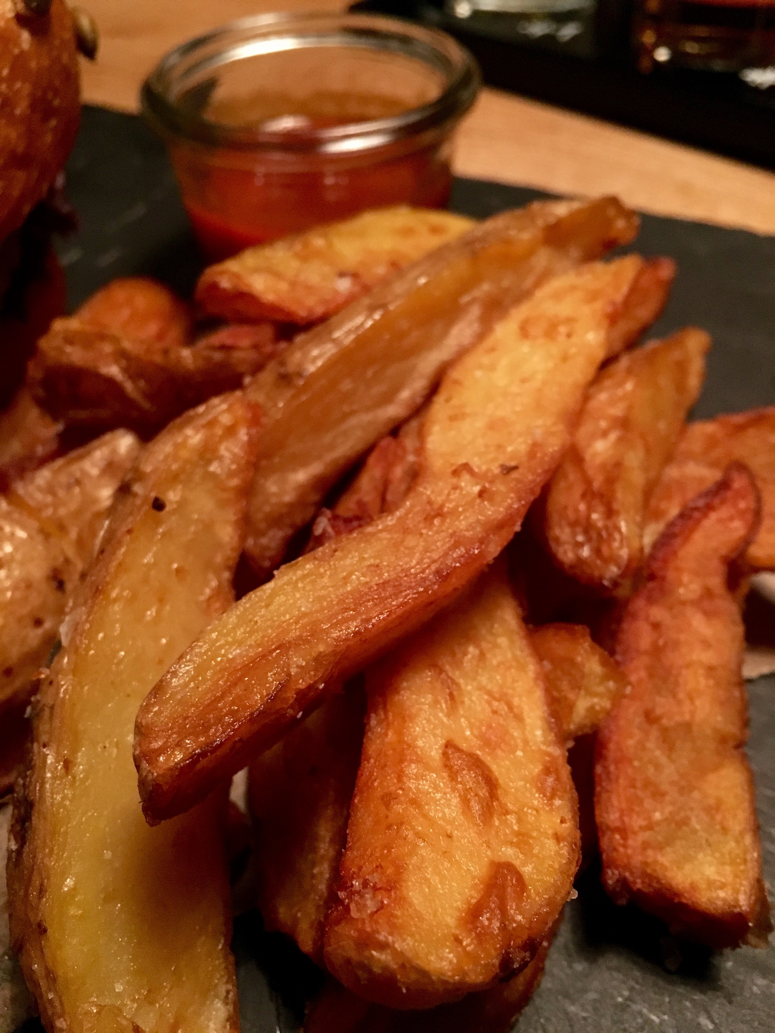Homemade potato wedges and ketchup