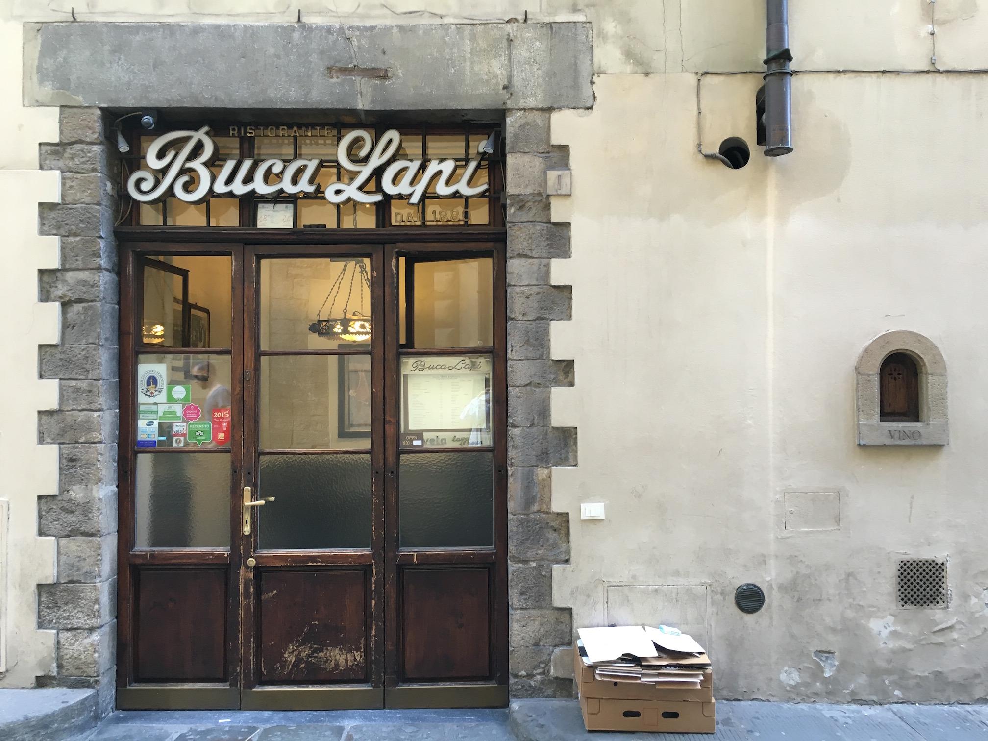 Buca Lapi 's wine door at the right