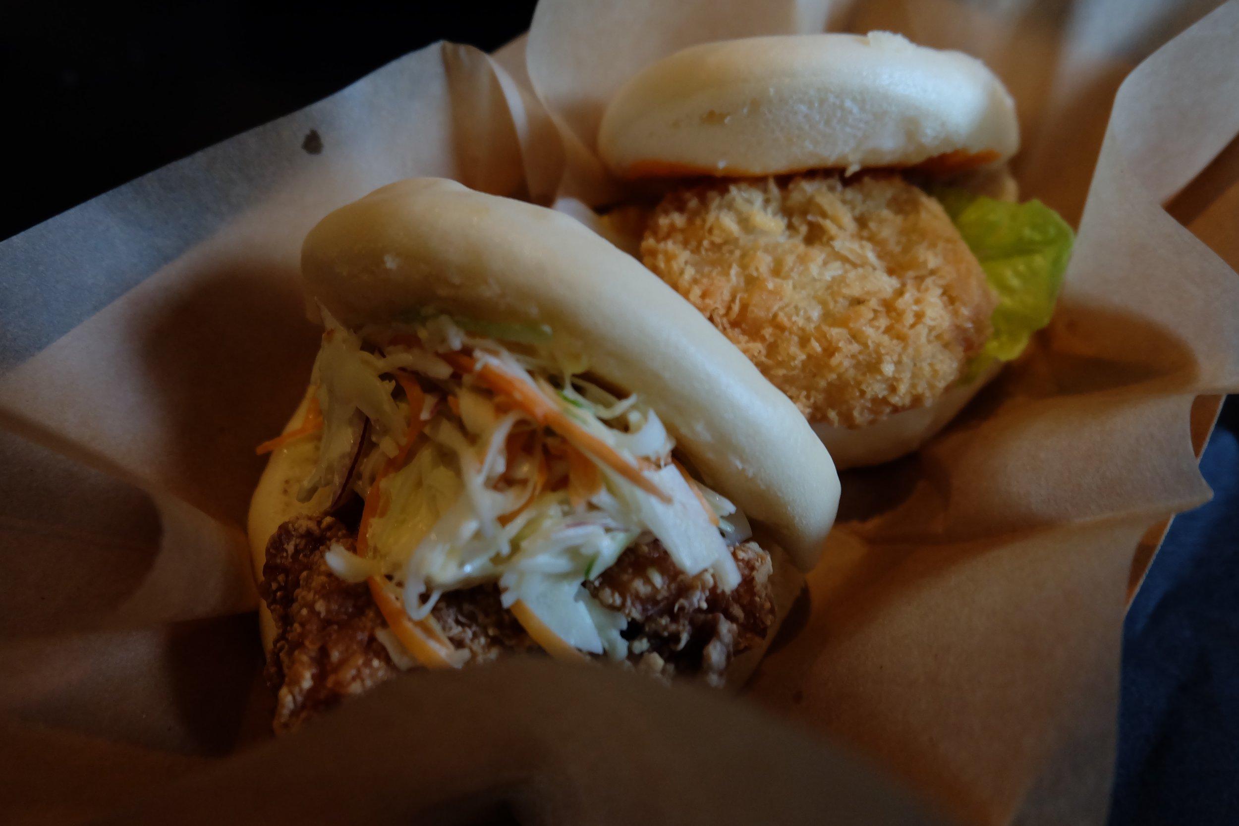 A close-up of the chicken  karaage bun (front) and  ebi kat  su bun at Beer and Buns