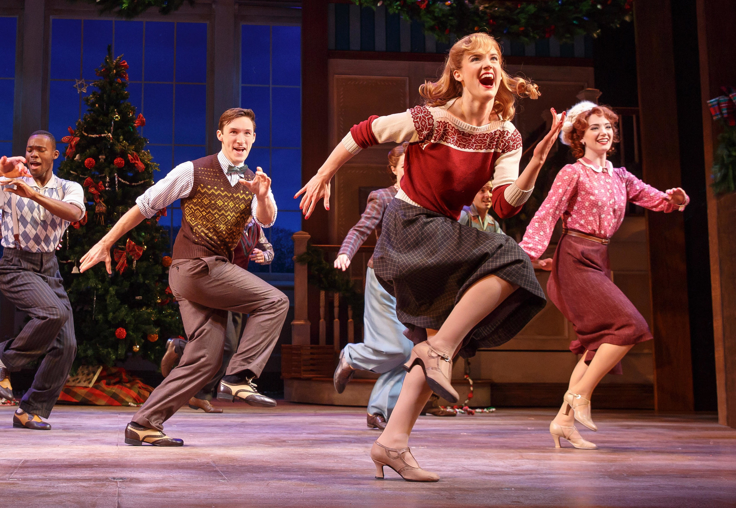 Jonalyn Saxer (center, with the cast of Broadway's  Holiday Inn )