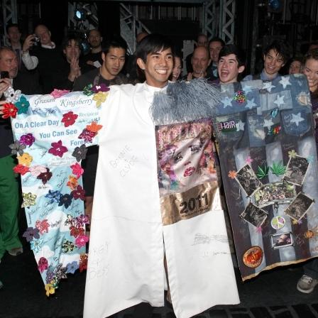 Aaron J. Albano receiving the Robe for  Newsies