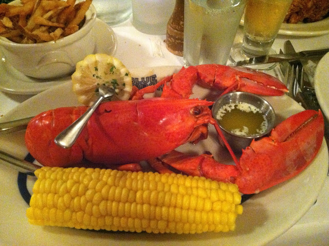 Lobster Main Course dish with corn on the cob and french fries