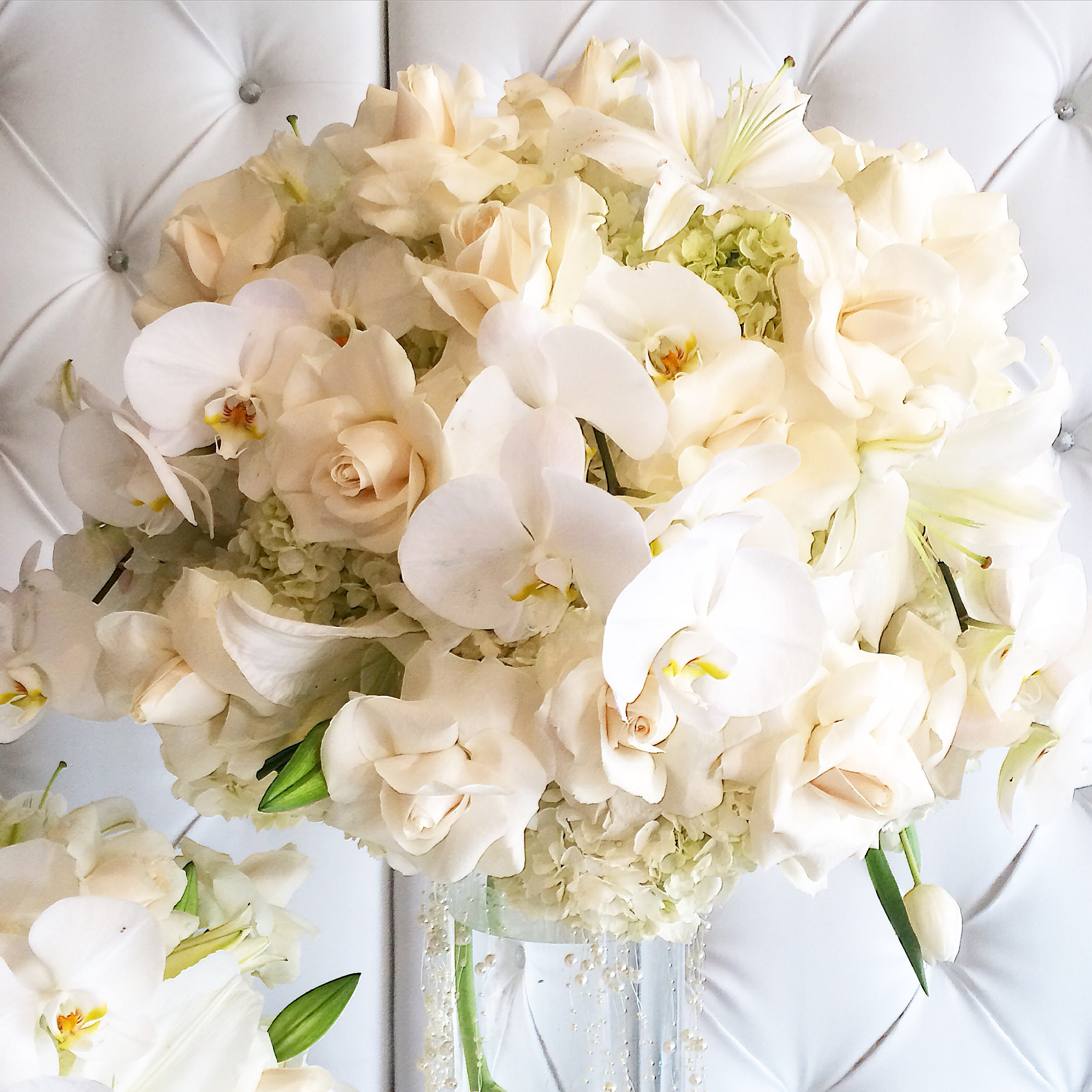 White centerpiece with orchids.JPG