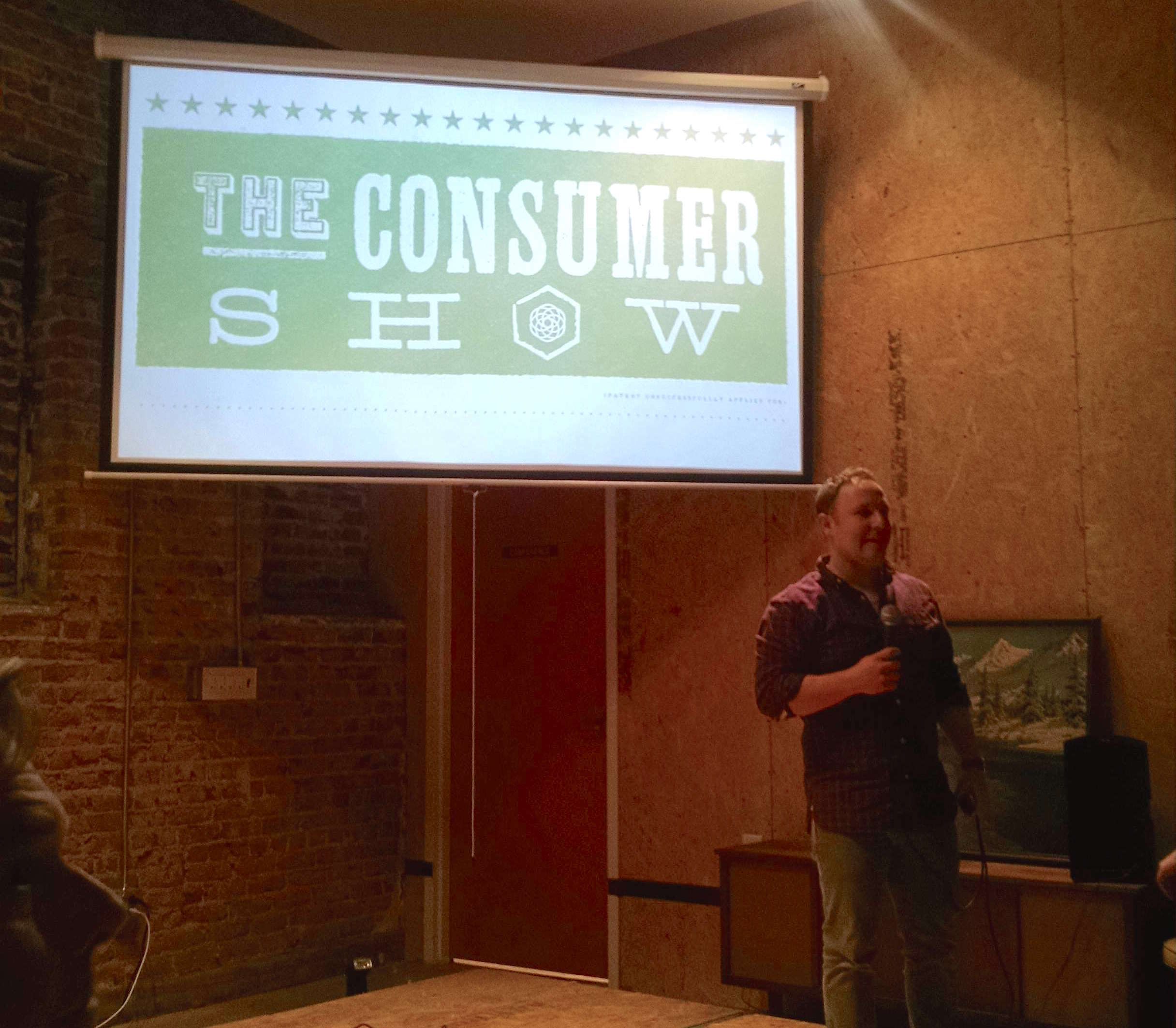 Michael Tavani    kicks off  the April Consumer Show at Switchyards with some housekeeping items. (In case you were wondering, yes, we can hear you when you talk in the bathrooms.)