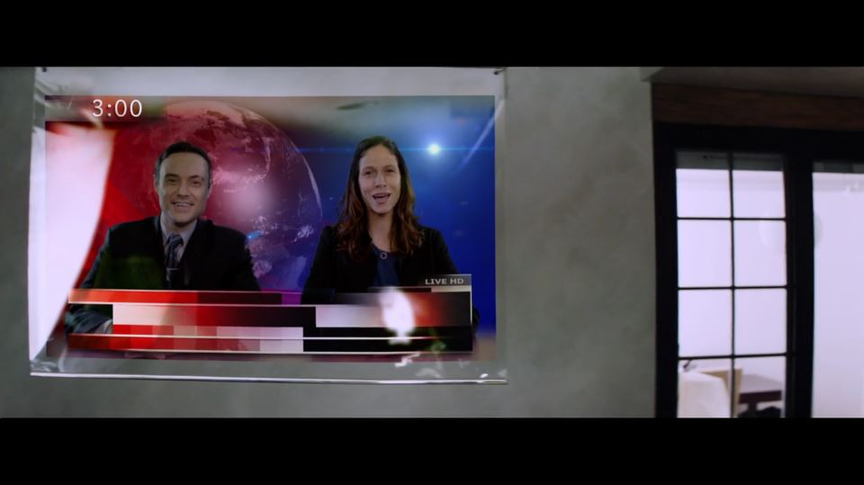 As a dystopian news anchor in THE GIRAFFE WHO KNEW TOO MUCH, a short film by  Eric Tosstorff