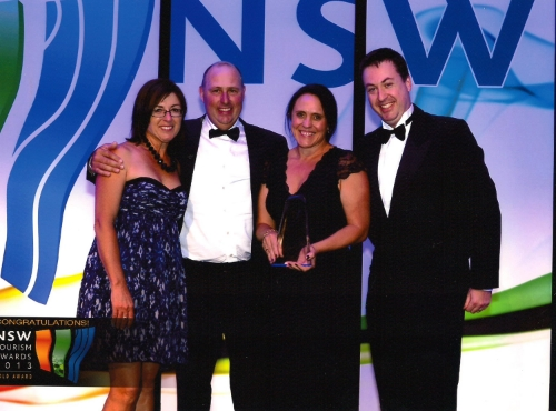 Libby with the Nambucca River Tourist Park team winning Gold at the NSW State Tourism Awards, 2013.