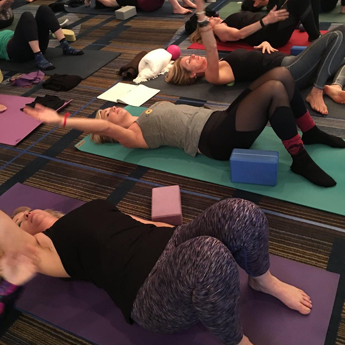 That's me making a weird face as  Bo Forbes  shows us how to do self body work at Yoga Journal LIVE! Breaking up that fascia!